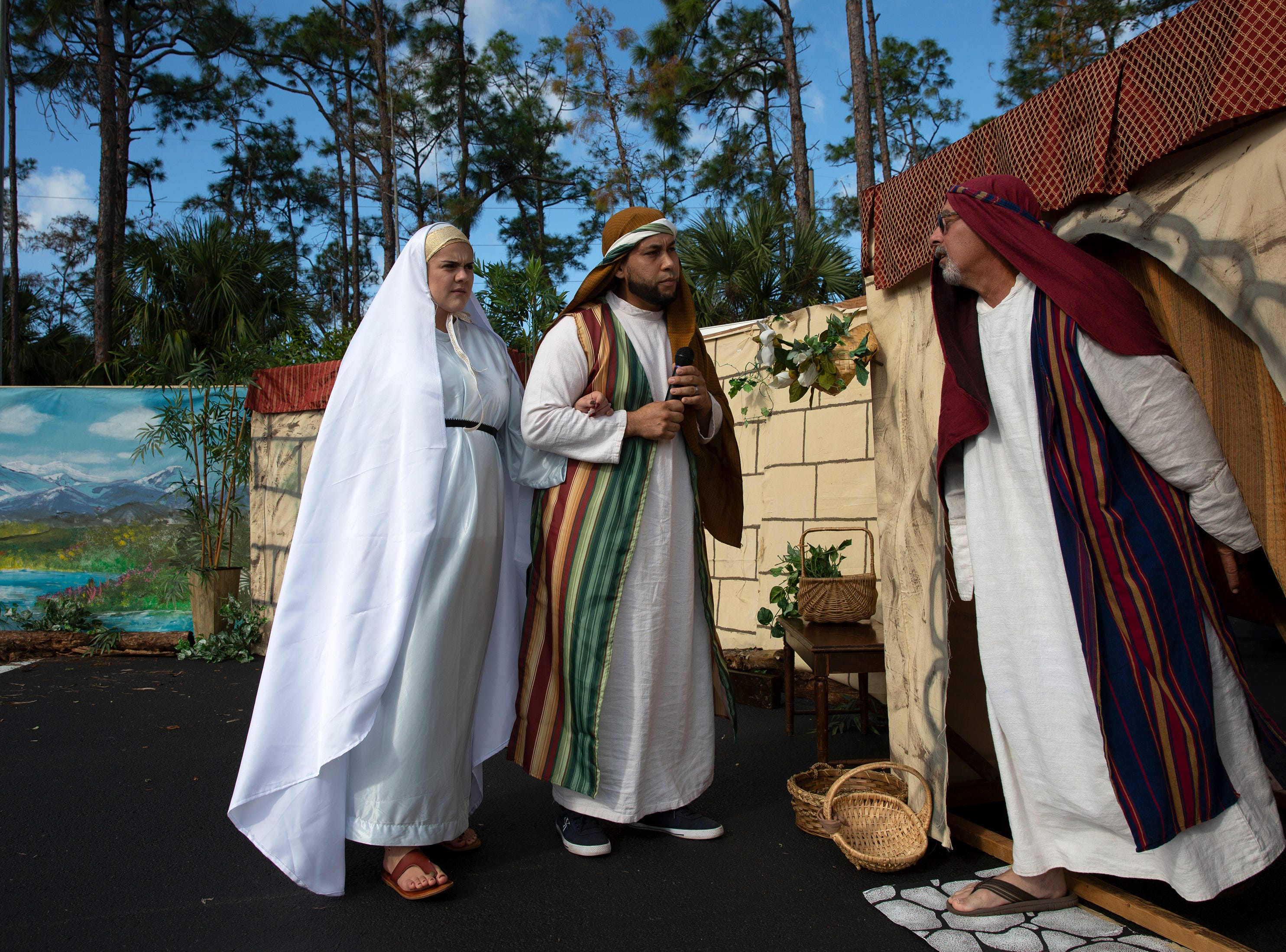Daniela and Julio Laverde, left, play Mary and Joseph as they search for lodging  in Bethlehem during a live nativity scene at St. Agnes Catholic Church on Sunday, Dec. 16, 2018, in East Naples.