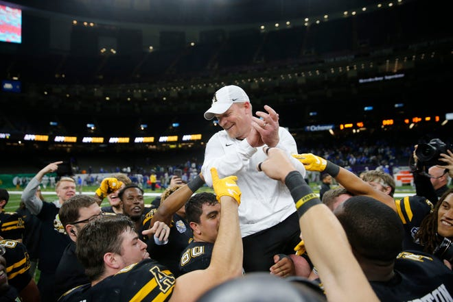 Appalachian State players carry interim head coach Mark Ivey after their victory over Middle Tennessee in the New Orleans Bowl in New Orleans on Saturday. Appalachian State won 45-13. (AP Photo/Gerald Herbert)
