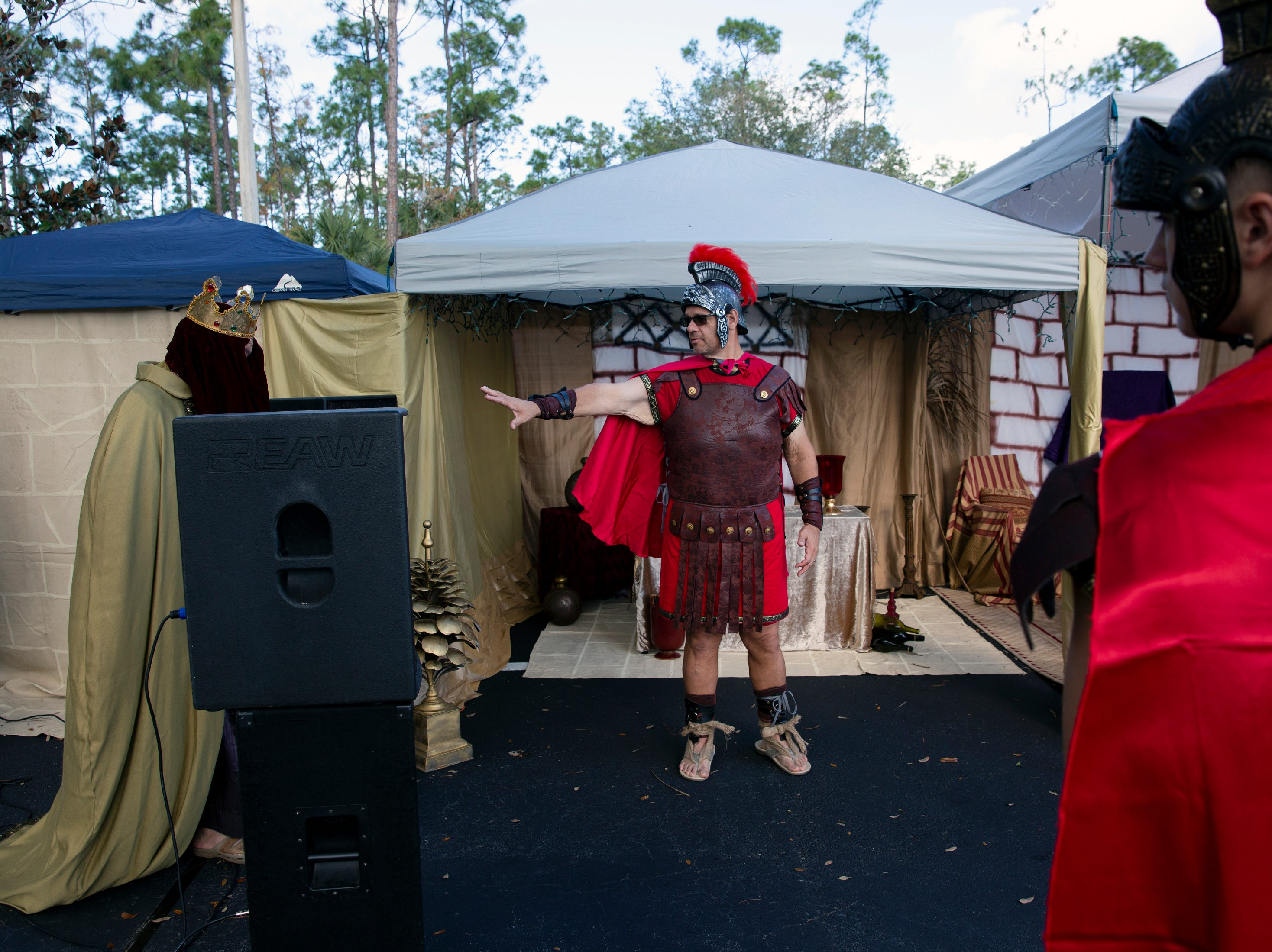 A Roman centurion played by Jeff Vespos acts out a scene during a live nativity performance at St. Agnes Catholic Church on Sunday, Dec. 16, 2018, in East Naples.