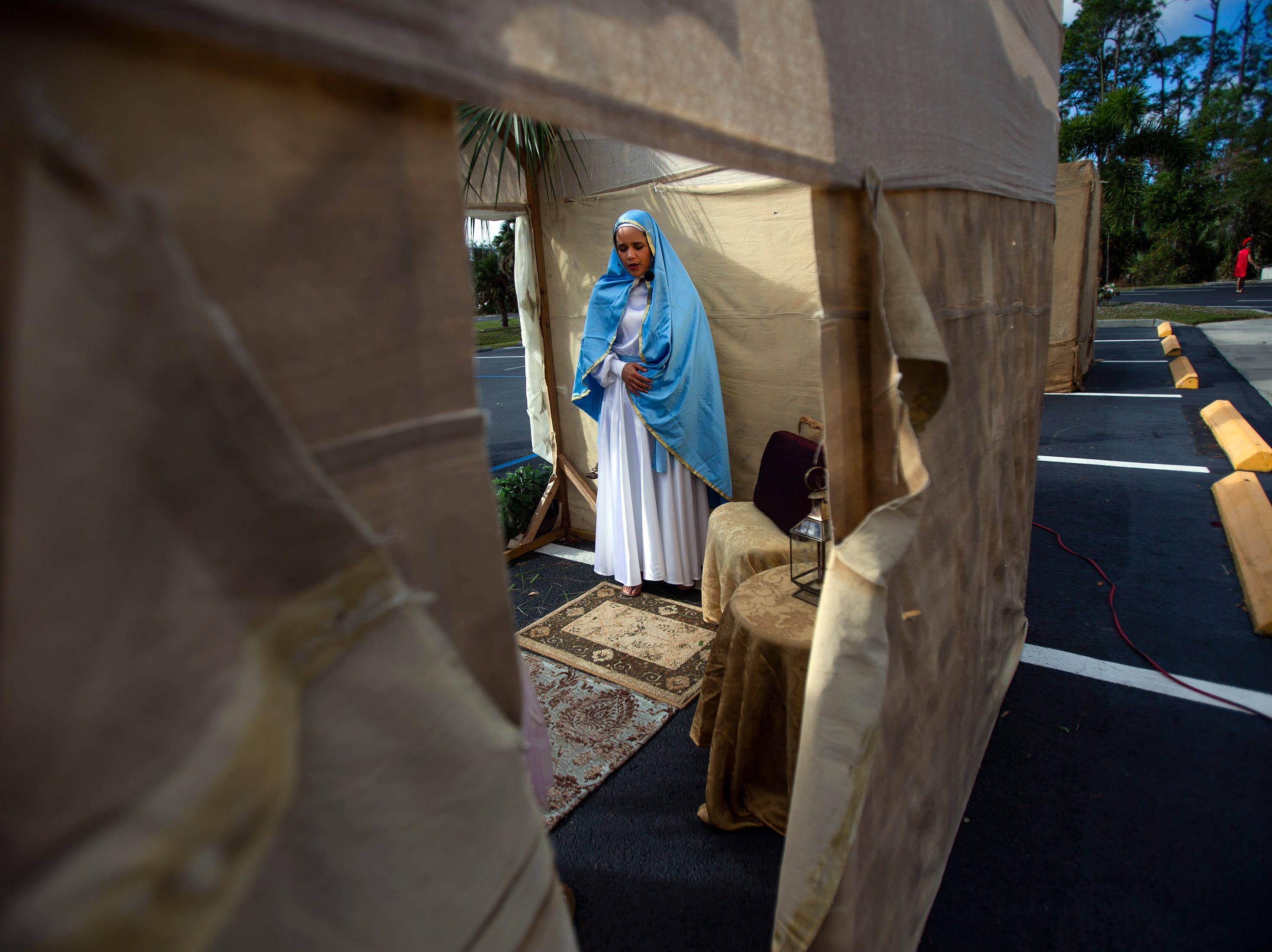 Sofia Velez plays Mary in the Annunciation to the Blessed Virgin Mary scene of the live nativity at St. Agnes Catholic Church on Sunday, Dec. 16, 2018, in East Naples.