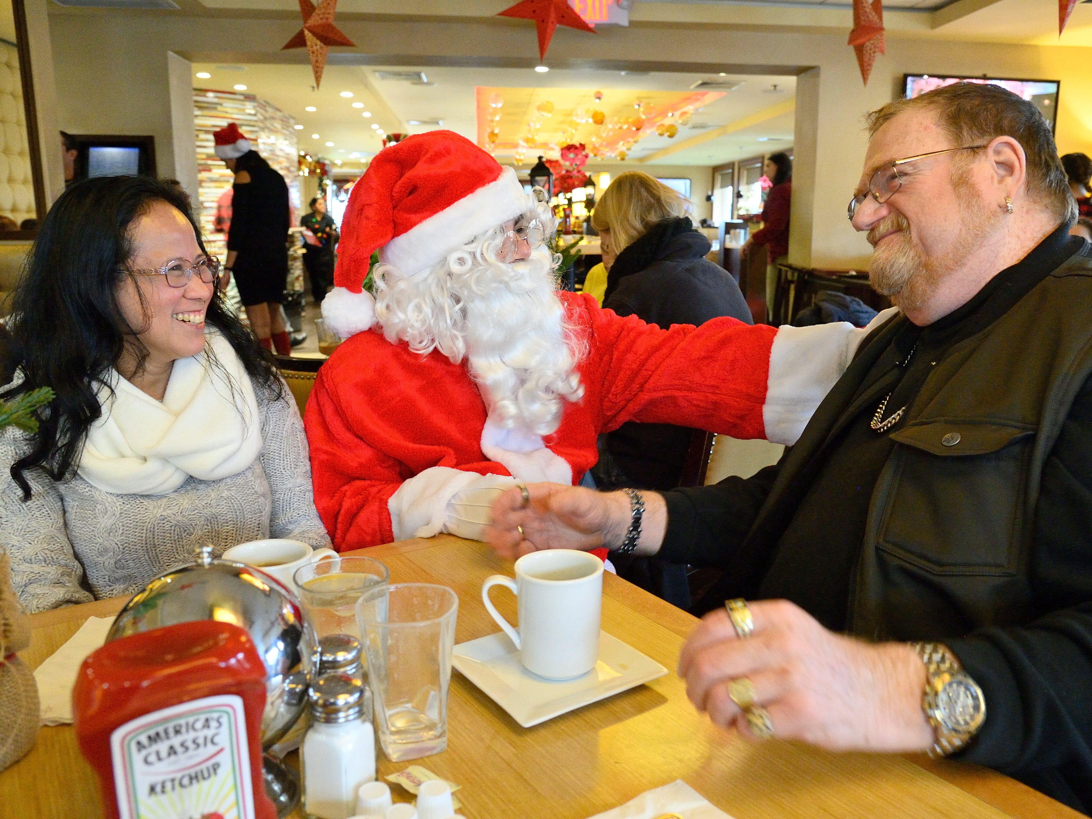 Santa greets Darlina and Bob Wood of Wallington at the Candlewyck Diner in East Rutherford on Saturday, Dec. 15, 2018