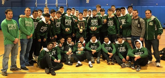 Passaic Valley coaches and wrestlers after the Hornets won the 10-team Mahwah Tournament.