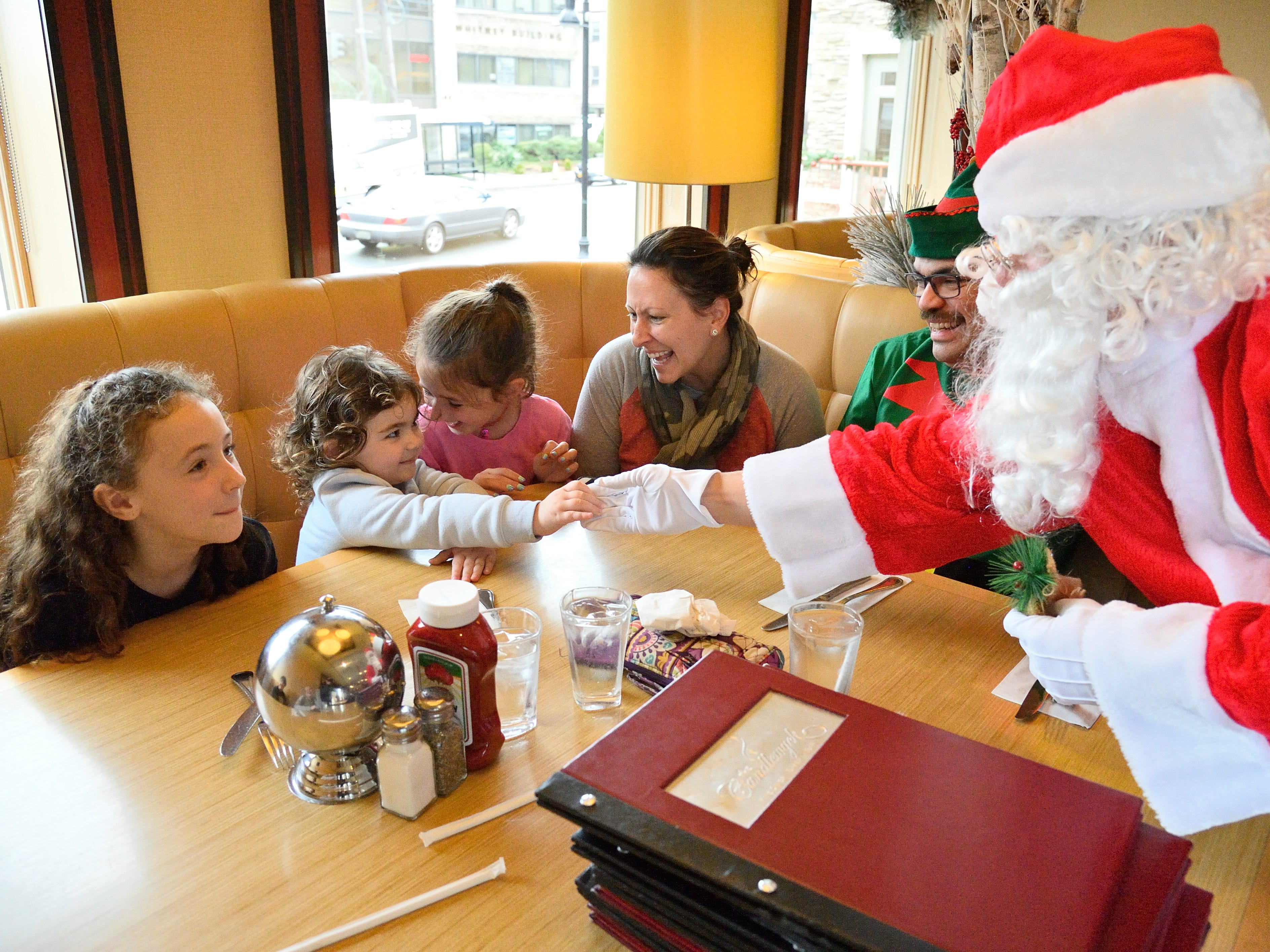 Santa greets, L to R, Kayla Knapp, Rylie Sanchaz, Alexis Floriani, Michele Rubbinaccio and Rafael Sanchez the Elf at the Candlewyck Diner in East Rutherford on Saturday, Dec. 15, 2018