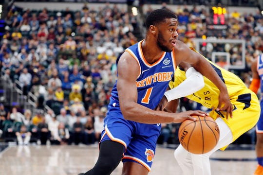 New York Knicks guard Emmanuel Mudiay (1) drives to the basket against Indiana Pacers guard Darren Collison (2) during the first quarter at Bankers Life Fieldhouse.