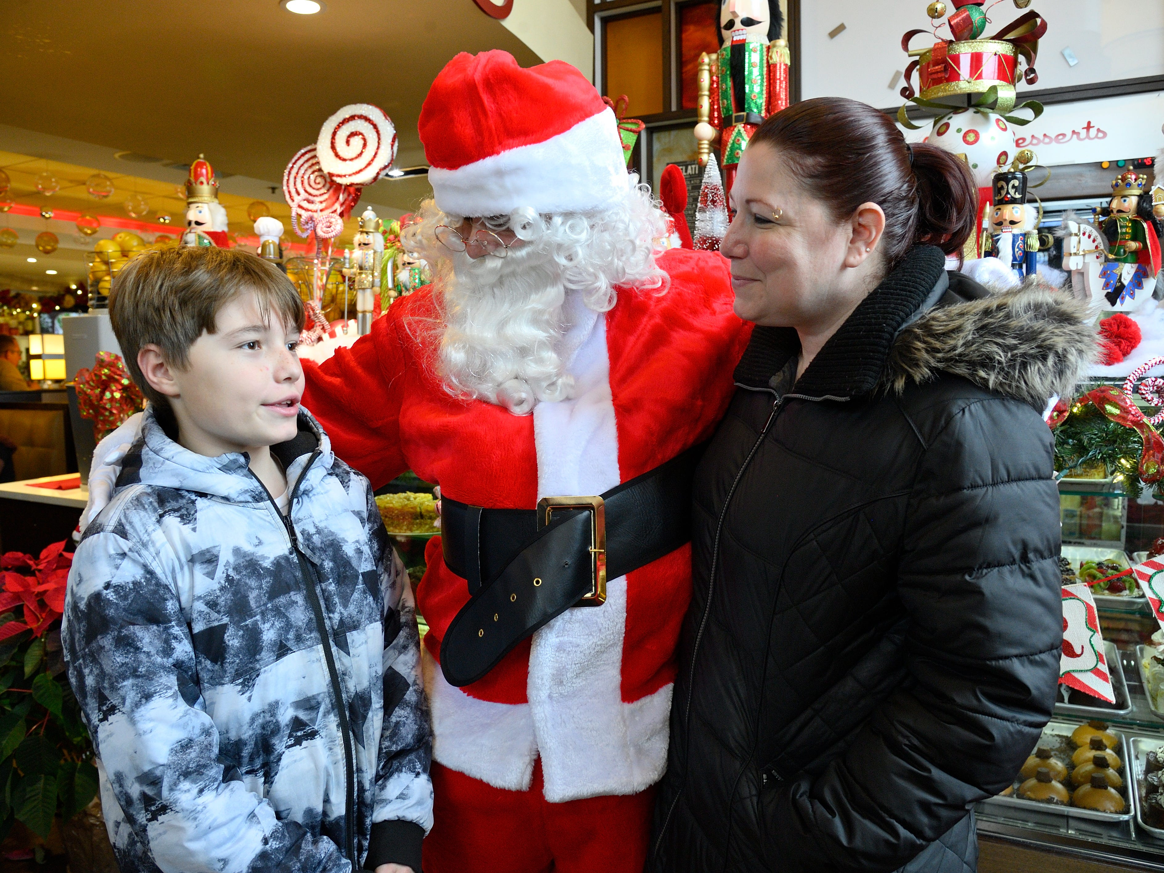 Santa greets Braedon McAuade and his mom Jeanette of Rutherford at the Candlewyck Diner in East Rutherford on Saturday, Dec. 15, 2018