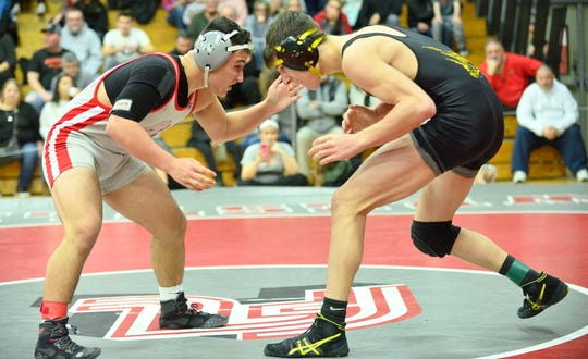 Fair Lawn's AJ Puerto, grey, wrestles Cresskill's Kenny Spadaccini in the 152 pound class at the Cutter Classic wrestling tournament in Fair Lawn on Saturday, Dec. 15, 2018