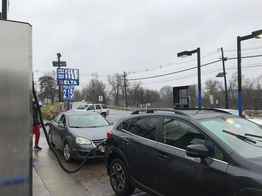 Cars back a Delta station on River Drive in Elmwood Park to take advantage of the low gas price on Sunday, Dec. 16, 2018.