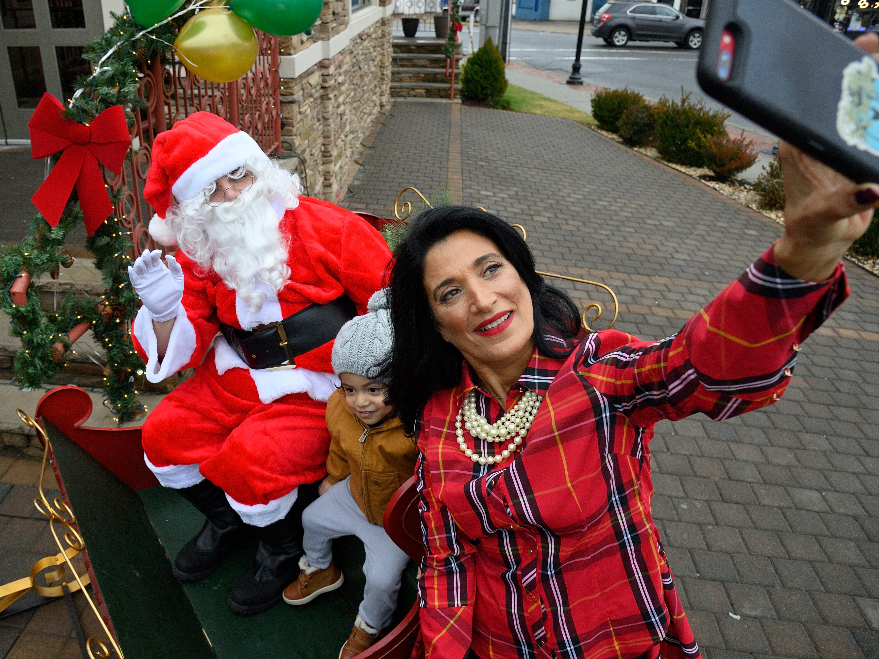 Canclewyck Diner owner Vasilia Logothetis takes a selfie with and Santa and  Gabriel Perez, 3, of Garfield on Saturday, Dec. 15, 2018