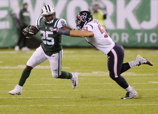 Texans at Jets at MetLife Stadium in East Rutherford on Saturday, December 15, 2018. J #25 Elijah McGuire fights off a tackle in the fourth quarter.