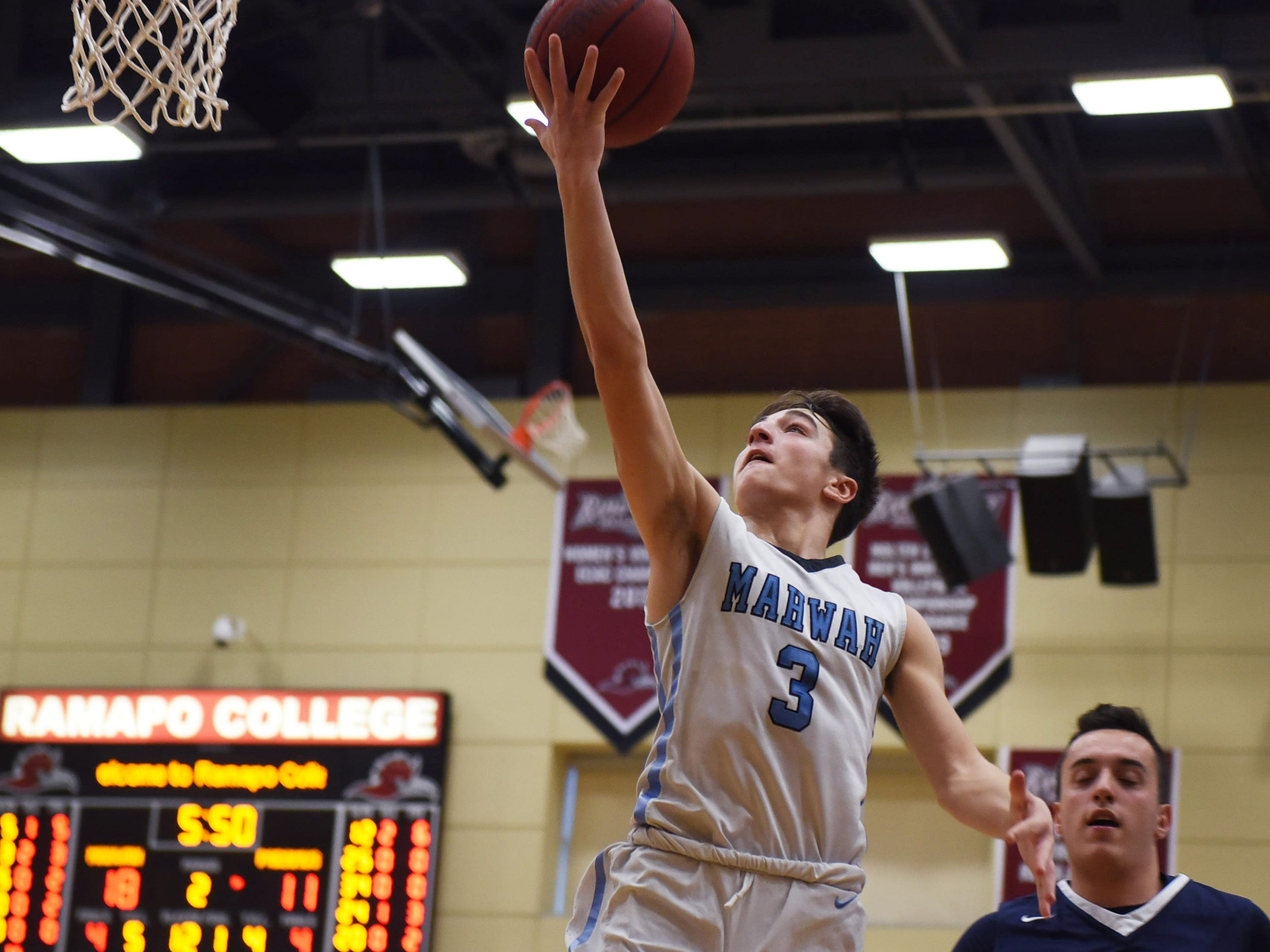 Nicky Peiteklan (no.3) of Mahwah (in white) goes to basket     in the first half during the Randy Chave Tip-Off boys basketball at Ramapo College in Mahwah on 12/16/18.
