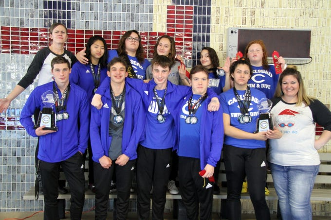 Carlsbad displays the medals and trophy won during Saturday's Christmas Swim Meet.
