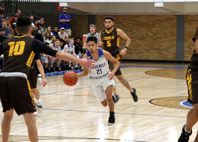 Patrick Espinoza drives against Cibola during Carlsbad's Dec. 15 game. Espinoza finished with eight points in Carlsbad's win.