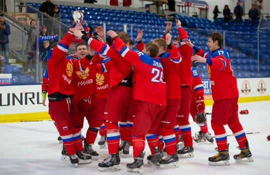 Celebrating after winning 3-2 in overtime Saturday, to claim the Under-17 Four Nations Cup trophy, is Team Russia.