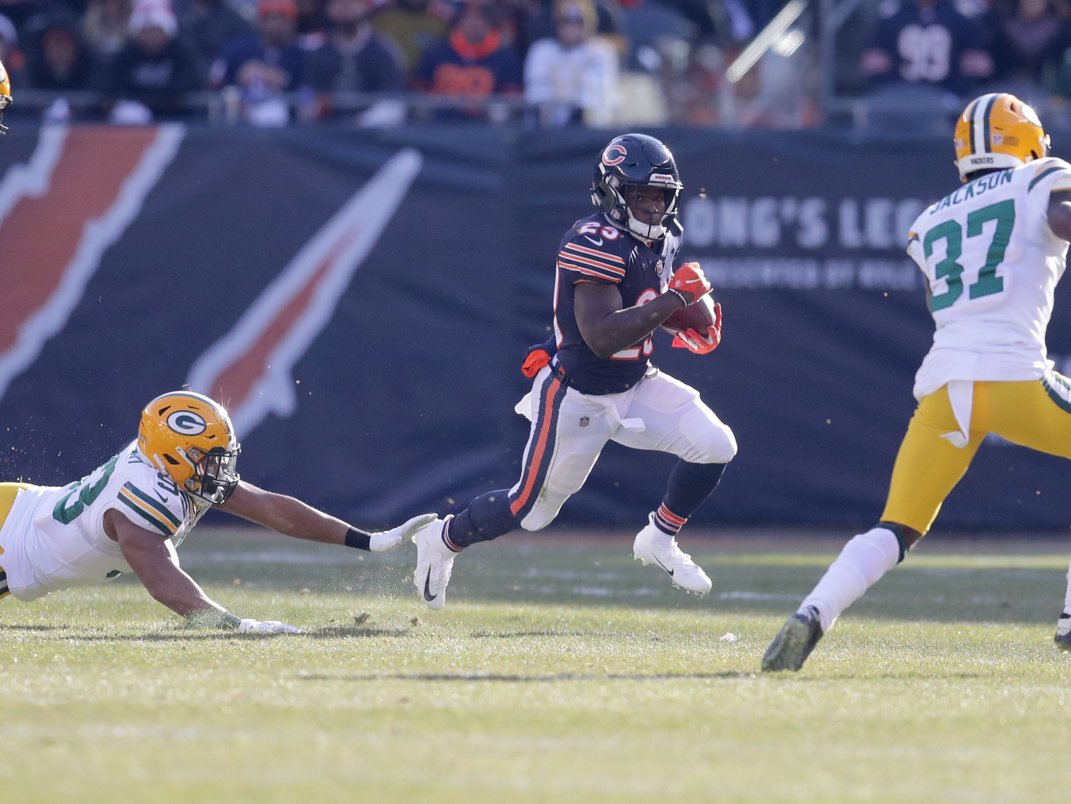 Chicago Bears' Tarik Cohen runs for a gain as Green Bay Packers defenders pursue during the 1st half of the Green Bay Packers game against the Chicago Bears at Soldier Field Sunday, Dec. 16, 2018, in Chicago. Photo by Mike De Sisti / The Milwaukee Journal Sentinel