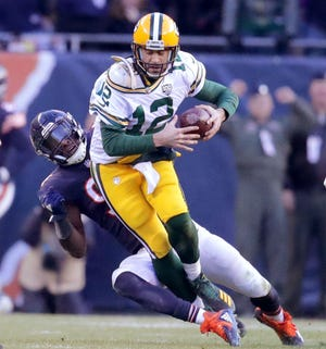 Green Bay Packers' Aaron Rodgers is sacked by Chicago Bears' Leonard Floyd during the 2nd half of the Green Bay Packers 24-17 loss to the Chicago Bears at Soldier Field Sunday, Dec. 16, 2018, in Chicago. Photo by Mike De Sisti / The Milwaukee Journal Sentinel