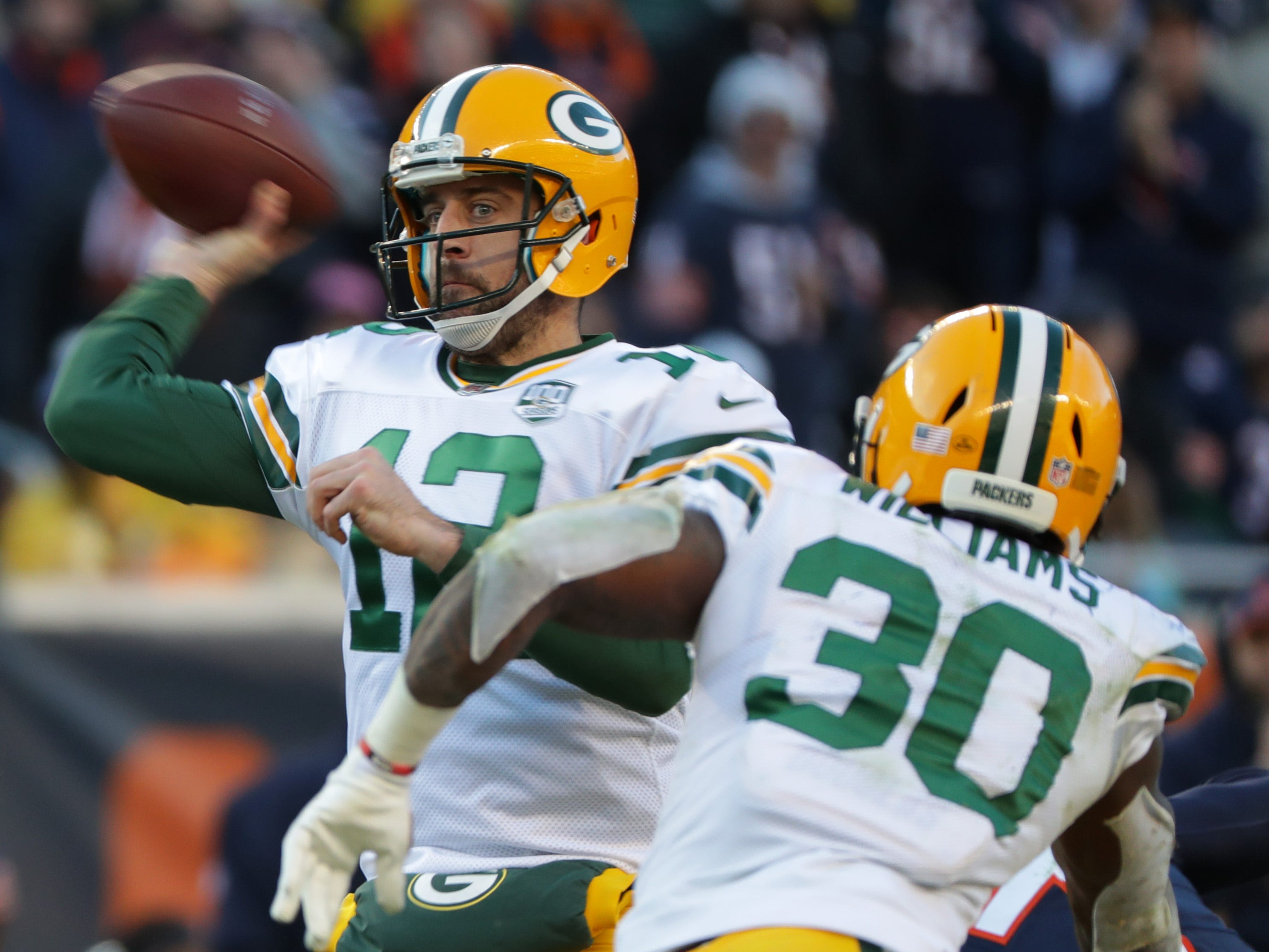 Green Bay Packers quarterback Aaron Rodgers (12) manages t get off a pass during the fourth quarter of their game against the Chicago Bears Sunday, December 25, 2018 at Soldier Field in Chicago, Ill. The Chicago Bears beat the Green Bay Packers 24-17.  MARK HOFFMAN/MILWAUKEE JOURNAL SENTINEL