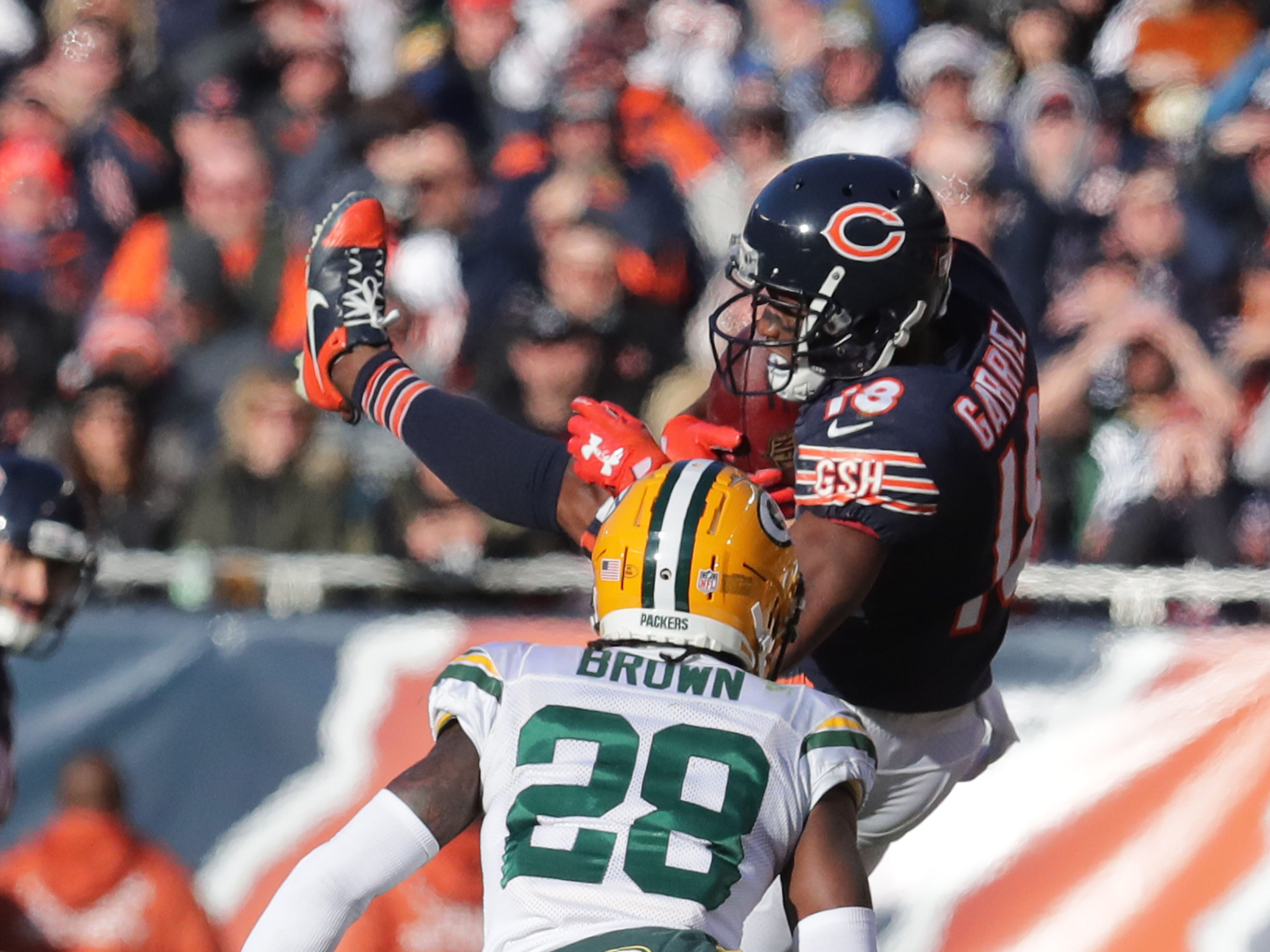 Chicago Bears' Taylor Gabriel catches a pass over Green Bay Packers' Tony Brown during the 2nd half of the Green Bay Packers 24-17 loss to the Chicago Bears at Soldier Field Sunday, Dec. 16, 2018, in Chicago. Photo by Mike De Sisti / The Milwaukee Journal Sentinel