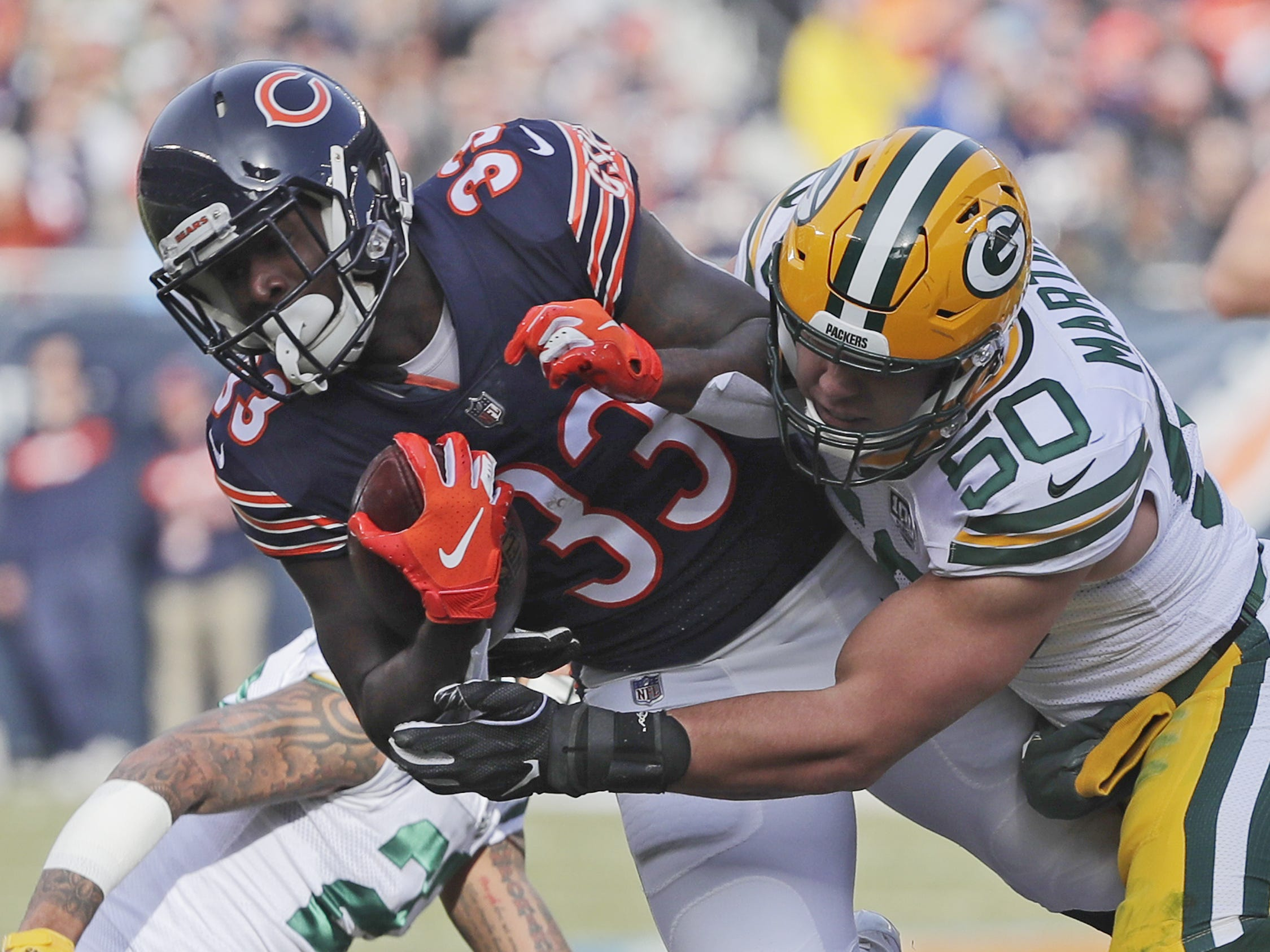 Green Bay Packers inside linebacker Blake Martinez (50) tackles Chicago Bears running back Taquan Mizzell (33) in the first quarter at Soldier Field on Sunday, December 16, 2018 in Chicago, Illinois. Adam Wesley/USA TODAY NETWORK-Wis