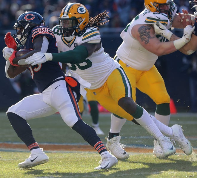 Green Bay Packers defensive end Fadol Brown (98) stops Chicago Bears running back Taquan Mizzell (33) short of a first down during the third quarter of their game Sunday, December 25, 2018 at Soldier Field in Chicago, Ill. The Chicago Bears beat the Green Bay Packers 24-17.  MARK HOFFMAN/MILWAUKEE JOURNAL SENTINEL
