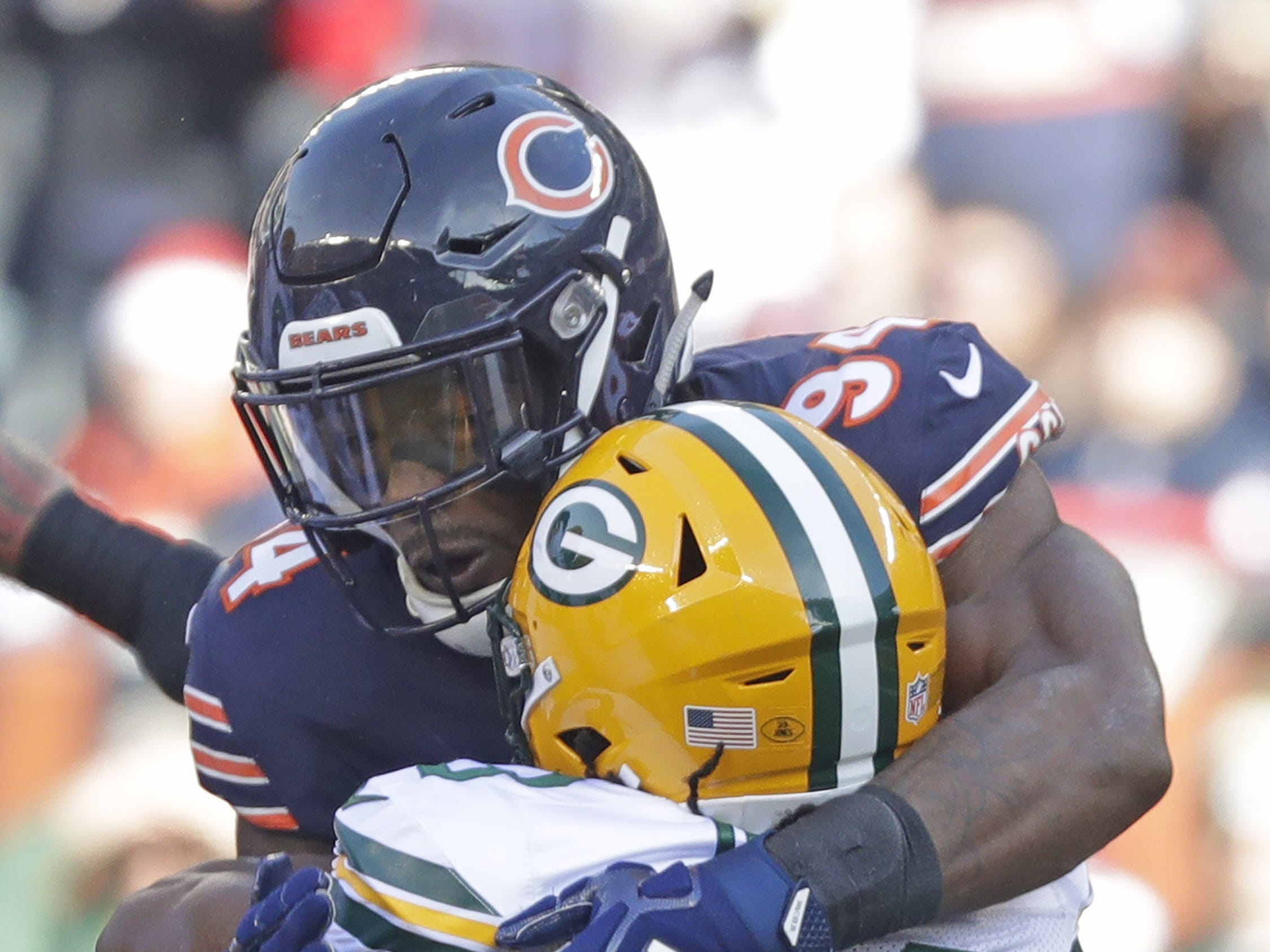 Chicago Bears outside linebacker Leonard Floyd (94) tackles Green Bay Packers running back Aaron Jones (33) in the first quarter at Soldier Field on Sunday, December 16, 2018 in Chicago, Illinois. Adam Wesley/USA TODAY NETWORK-Wis