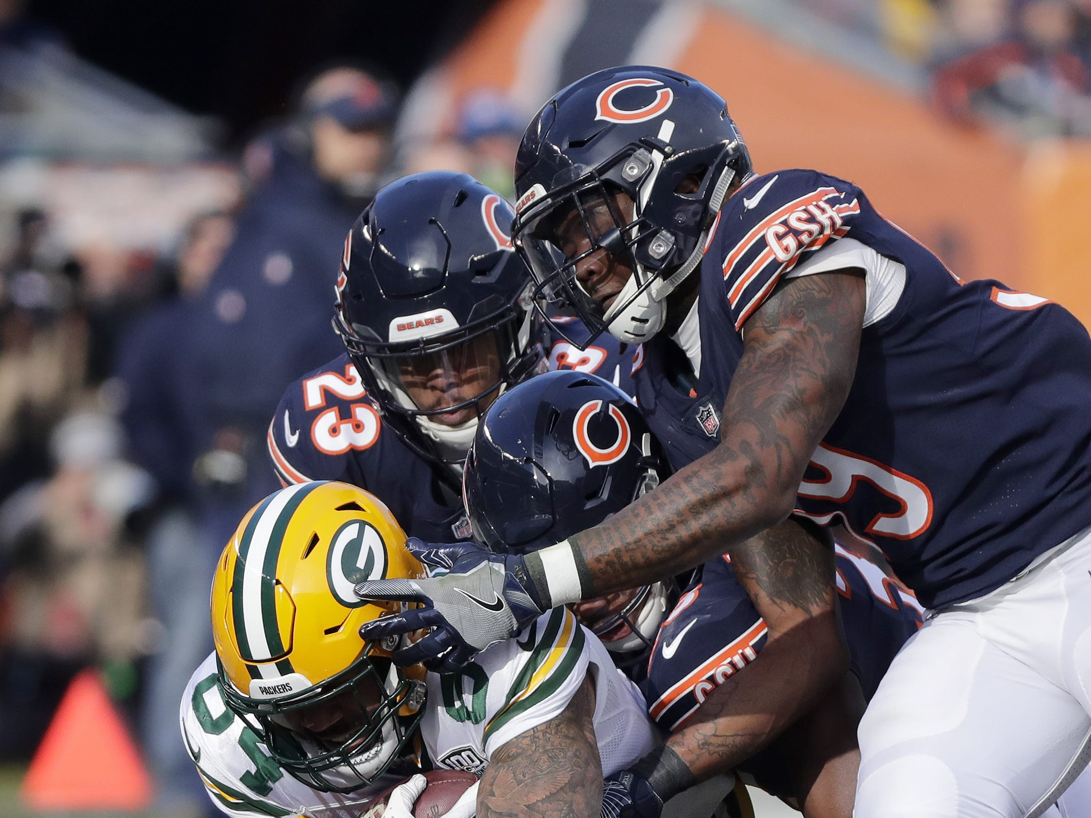 Green Bay Packers tight end Lance Kendricks (84) is tackled by a group of Chicago Bears in the second quarter at Soldier Field on Sunday, December 16, 2018 in Chicago, Illinois. Adam Wesley/USA TODAY NETWORK-Wis