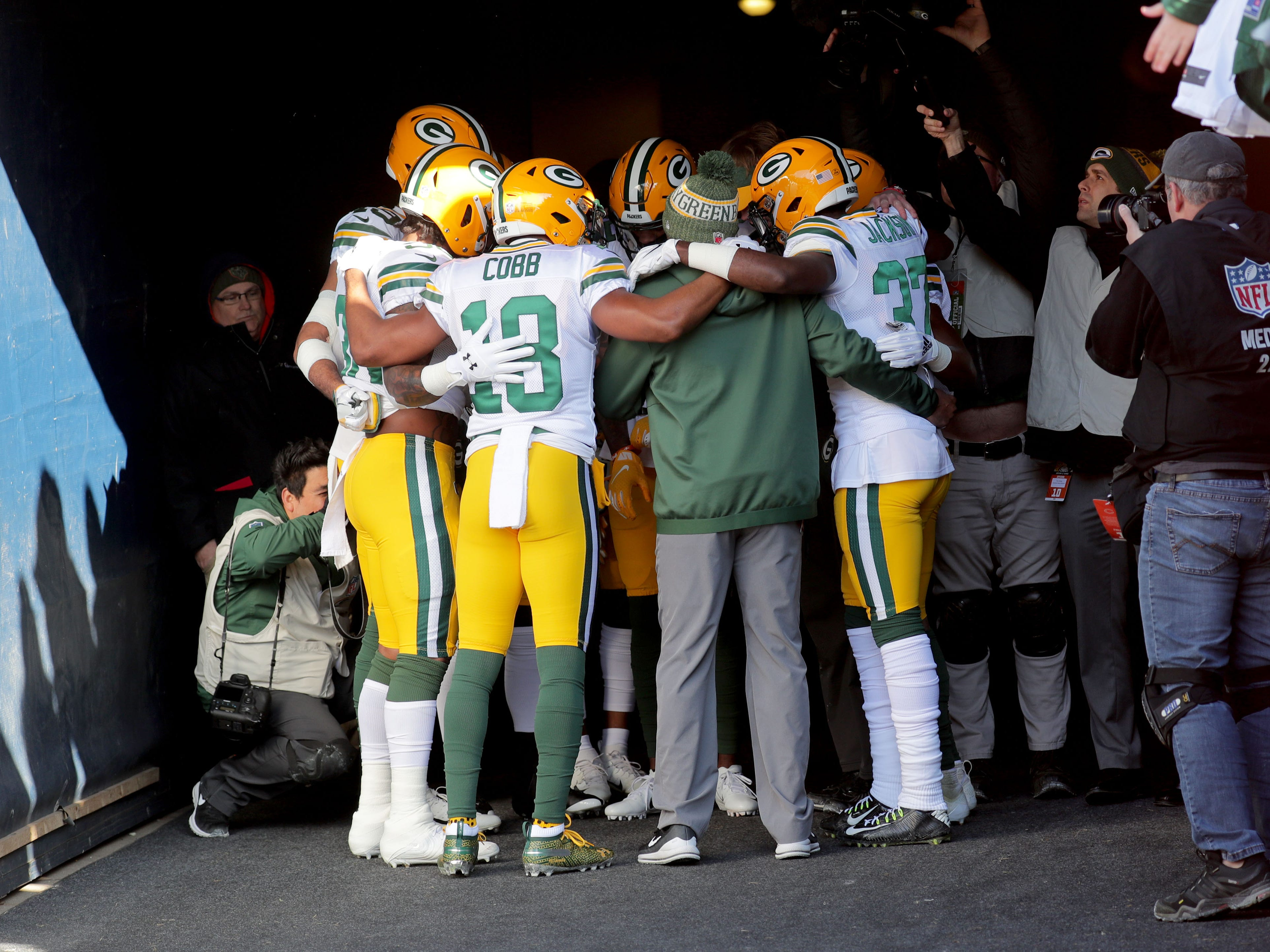 Members of he Green Bay Packers including Randall Cobb gather before heading on the field before practice before the Green Bay Packers game against the Chicago Bears at Soldier Field Sunday, Dec. 16, 2018, in Chicago.