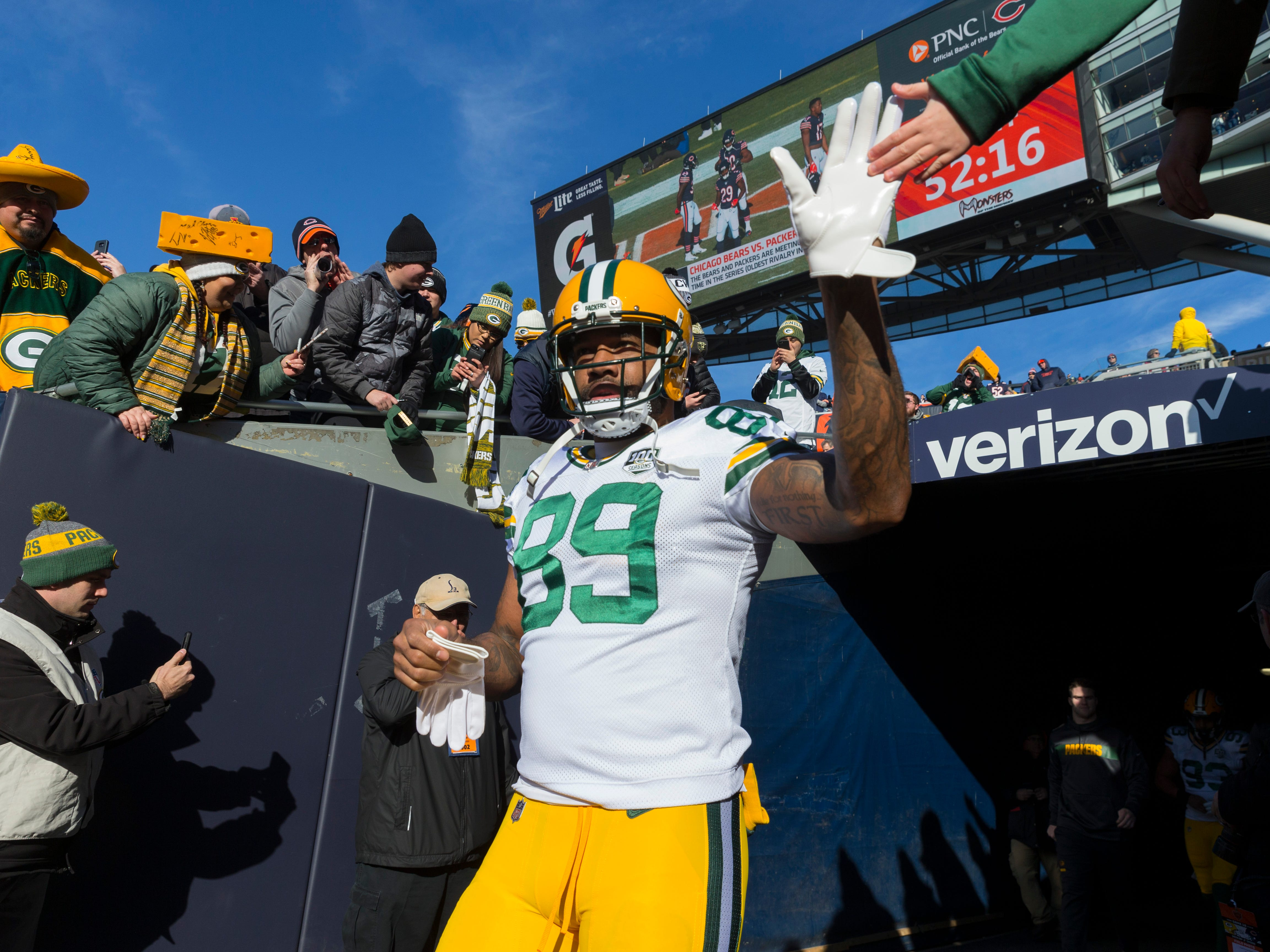 Green Bay Packers tight end Marcedes Lewis (89) greets a fan while taking to the field for warm ups  before their game against the Chicago Bears Sunday, December 25, 2018 at Soldier Field in Chicago, Ill.