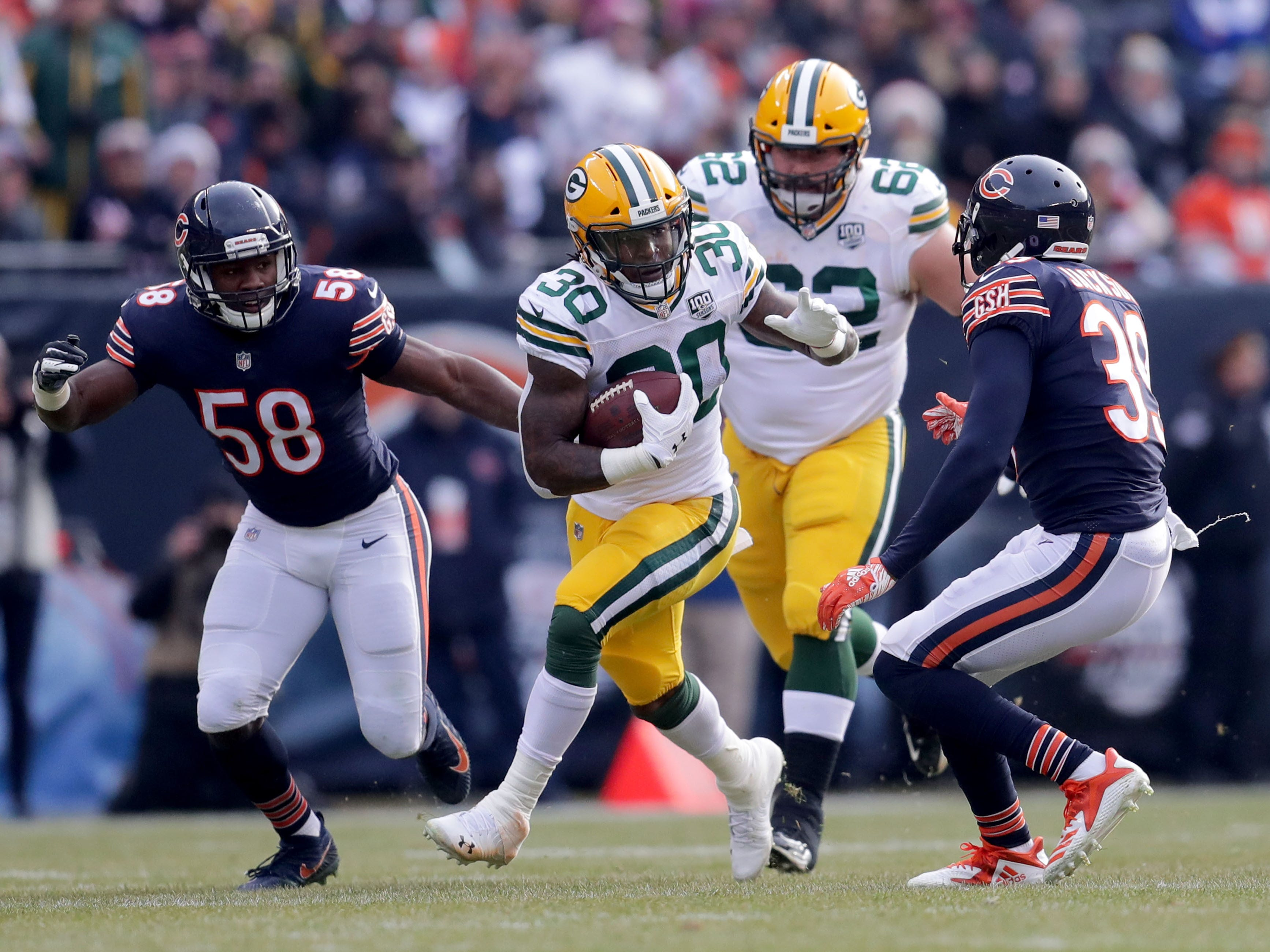 Green Bay Packers running back Jamaal Williams runs with the ball during the 1st half of the Green Bay Packers game against the Chicago Bears at Soldier Field Sunday, Dec. 16, 2018, in Chicago. Photo by Mike De Sisti / The Milwaukee Journal Sentinel