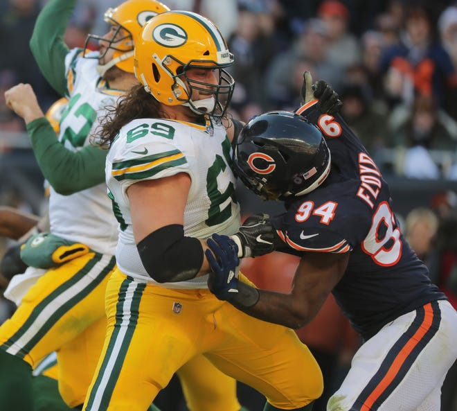 Green Bay Packers offensive tackle David Bakhtiari (69) blocks Chicago Bears outside linebacker Leonard Floyd (94) during the fourth quarter of their game in December at Soldier Field in Chicago.