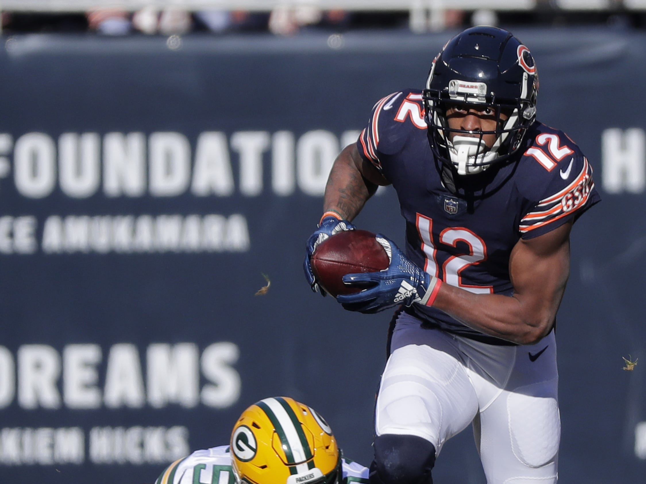 Chicago Bears wide receiver Allen Robinson (12) runs past Green Bay Packers inside linebacker Blake Martinez (50) in the first quarter at Soldier Field on Sunday, December 16, 2018 in Chicago, Illinois. Adam Wesley/USA TODAY NETWORK-Wis