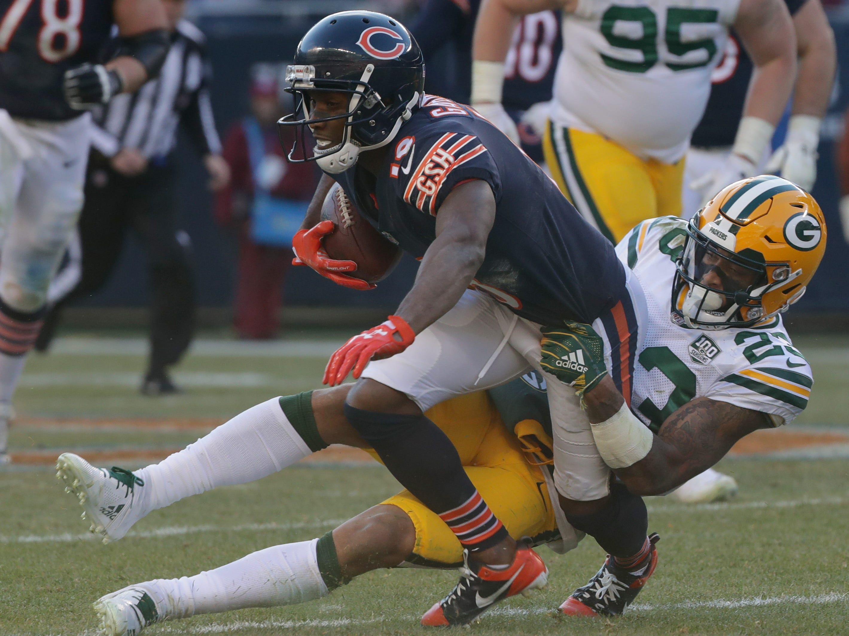 Green Bay Packers cornerback Jaire Alexander (23) tackles Chicago Bears wide receiver Taylor Gabriel (18) after a short reception during the fourth quarter of their game Sunday, December 25, 2018 at Soldier Field in Chicago, Ill. The Chicago Bears beat the Green Bay Packers 24-17.  MARK HOFFMAN/MILWAUKEE JOURNAL SENTINEL