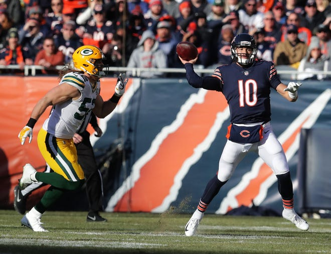 Chicago Bears' Mitchell Trubisky looks to pass as Green Bay Packers' Clay Matthews pursues during the 2nd half of the Green Bay Packers 24-17 loss to the Chicago Bears at Soldier Field Sunday, Dec. 16, 2018, in Chicago. Photo by Mike De Sisti / The Milwaukee Journal Sentinel