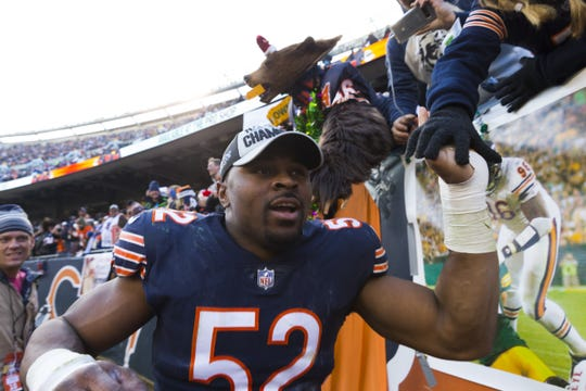 Chicago Bears outside linebacker Khalil Mack (52) celebrates their win sending the into the playoffs after their game Sunday, December 25, 2018 at Soldier Field in Chicago, Ill. The Chicago Bears beat the Green Bay Packers 24-17.  MARK HOFFMAN/MILWAUKEE JOURNAL SENTINEL
