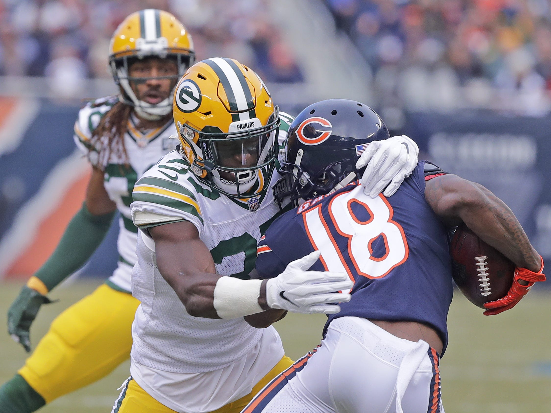 Green Bay Packers cornerback Josh Jackson (37) tackles Chicago Bears wide receiver Taylor Gabriel (18) in the second quarter at Soldier Field on Sunday, December 16, 2018 in Chicago, Illinois. Adam Wesley/USA TODAY NETWORK-Wis