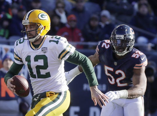 Green Bay Packers quarterback Aaron Rodgers (12) scrambles away from Chicago Bears outside linebacker Khalil Mack (52) in the third quarter at Soldier Field on Sunday, December 16, 2018 in Chicago, Illinois. Adam Wesley/USA TODAY NETWORK-Wis