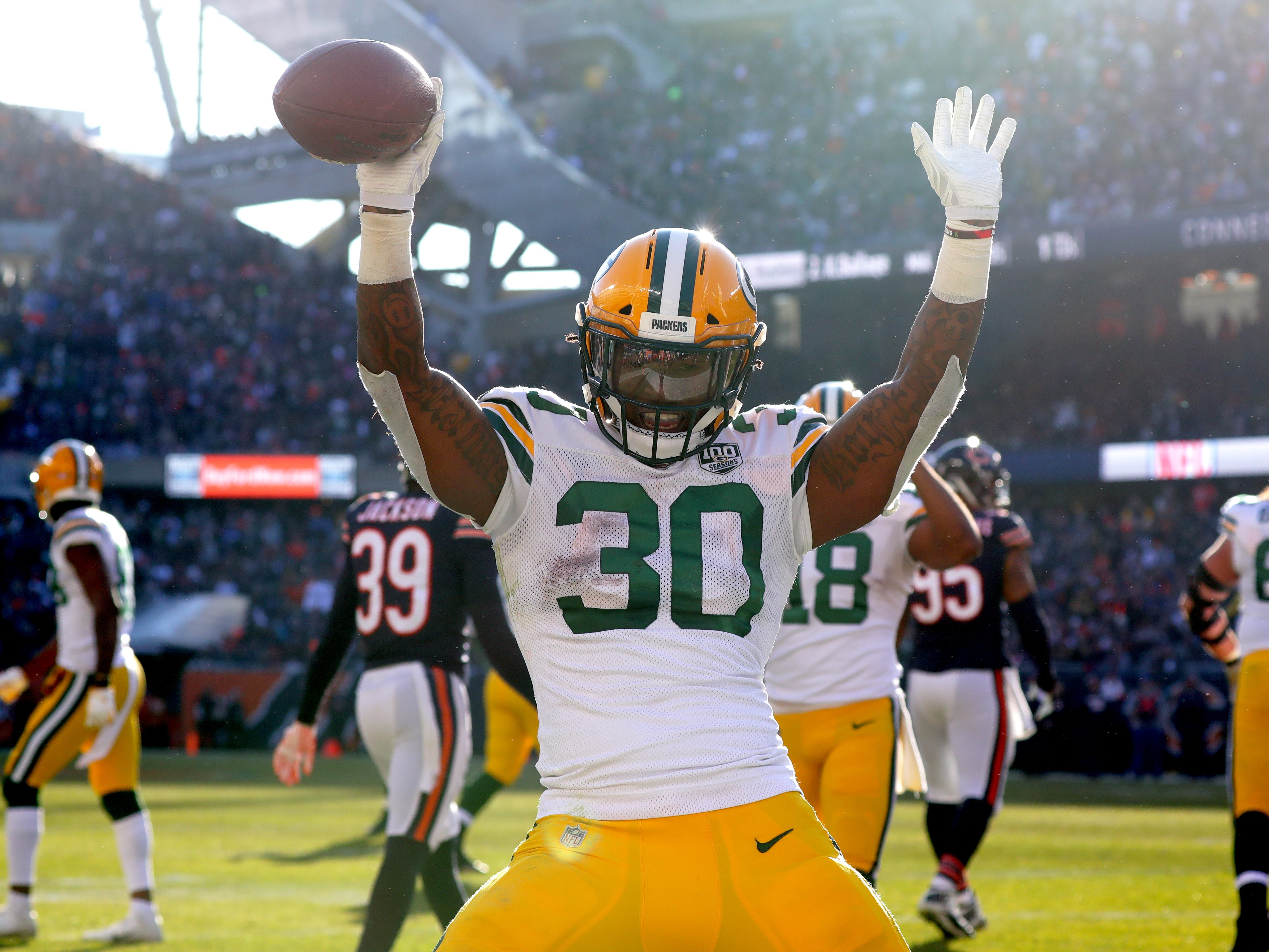 Green Bay Packers running back Jamaal Williams (30) celebrates his touchdown on a 10-yard run during the third  quarter of their game against the Chicago Bears Sunday, December 25, 2018 at Soldier Field in Chicago, Ill. The Chicago Bears beat the Green Bay Packers 24-17.  MARK HOFFMAN/MILWAUKEE JOURNAL SENTINEL