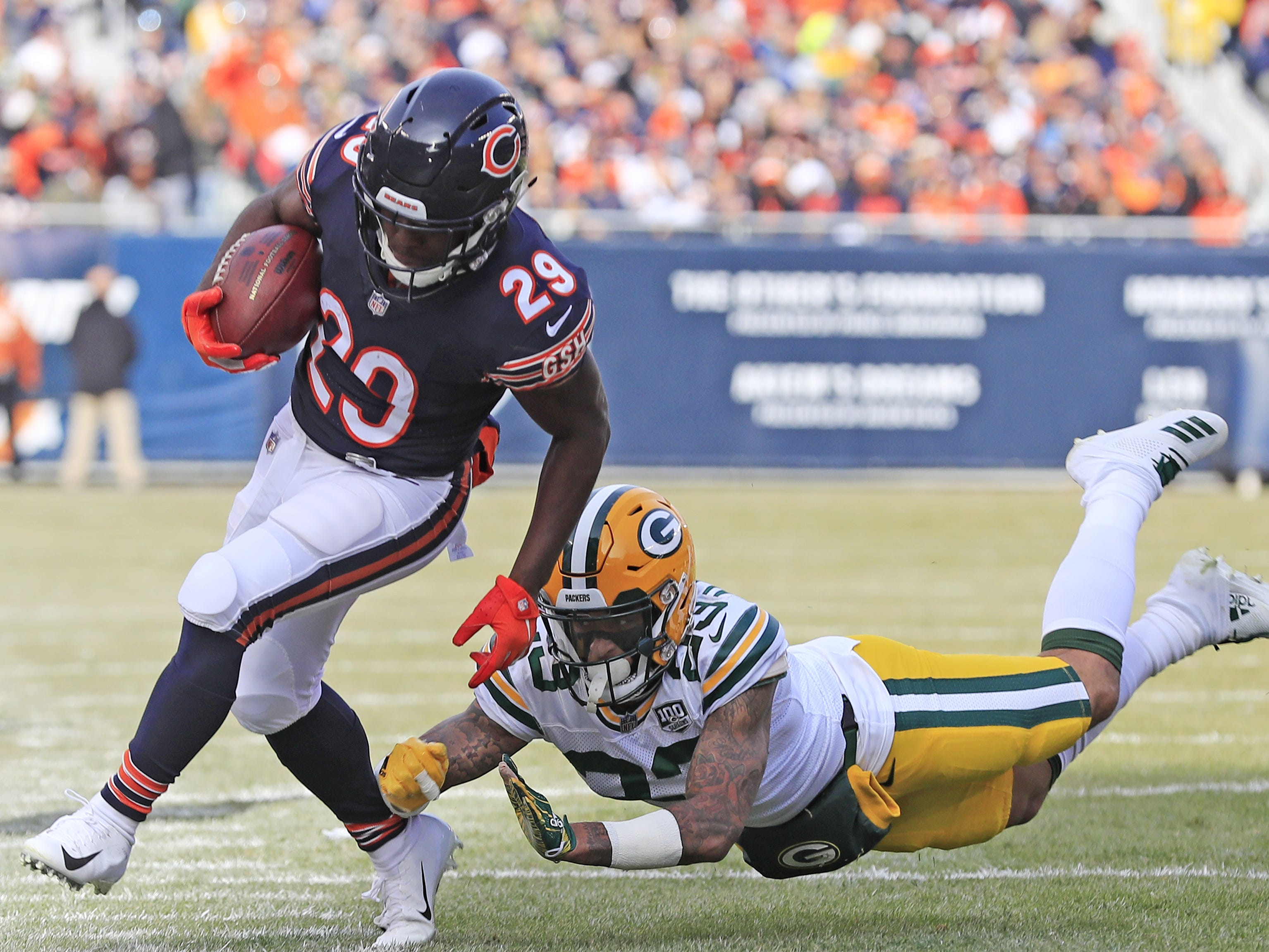 Green Bay Packers cornerback Jaire Alexander (23) knocks Chicago Bears running back Tarik Cohen (29) out of bounds in the first quarter at Soldier Field on Sunday, December 16, 2018 in Chicago, Illinois. Adam Wesley/USA TODAY NETWORK-Wis