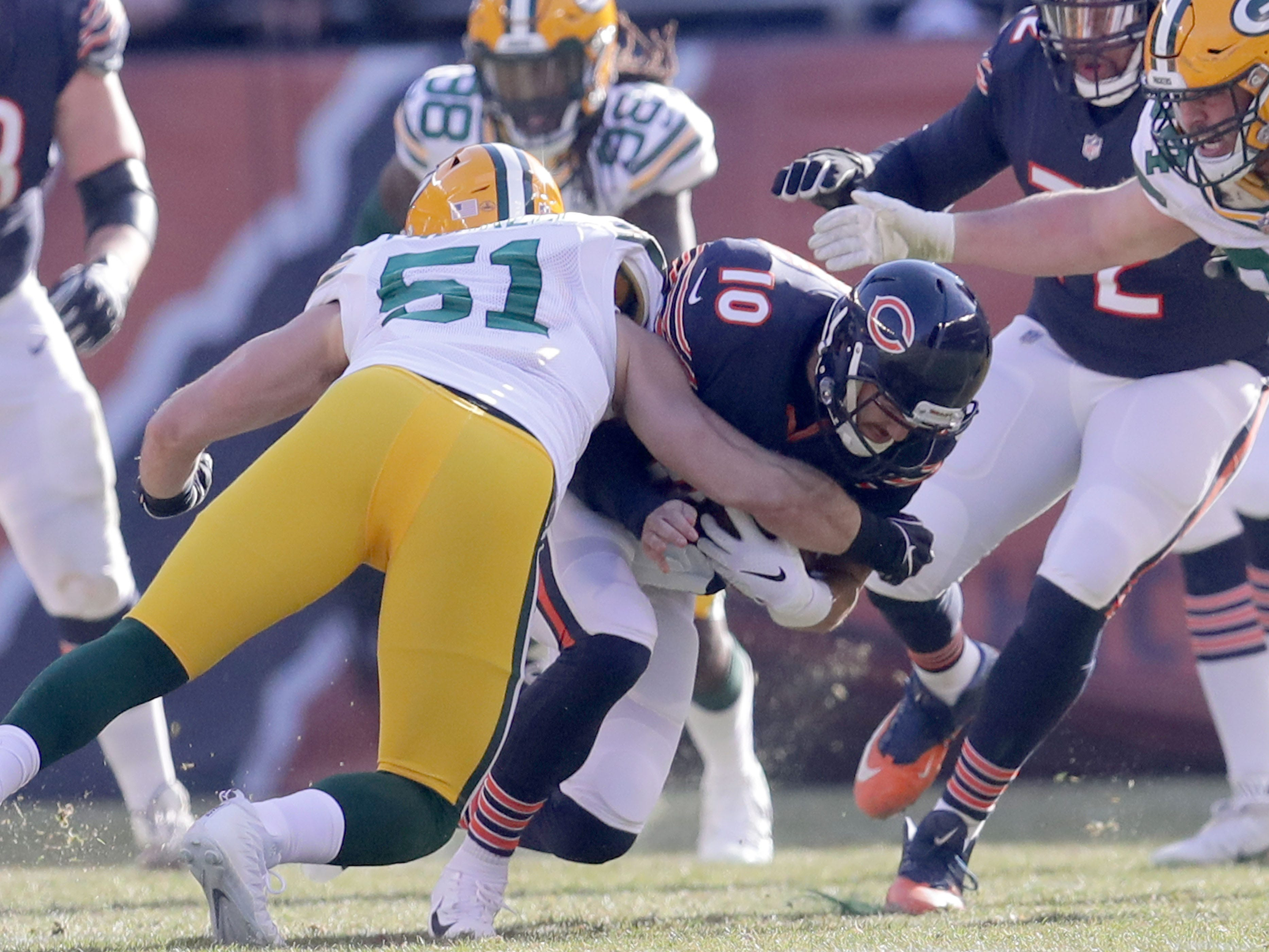 Chicago Bears' Mitchell Trubisky is sacked by Green Bay Packers' Kyler Fackrell during the 1st half of the Green Bay Packers game against the Chicago Bears at Soldier Field Sunday, Dec. 16, 2018, in Chicago. Photo by Mike De Sisti / The Milwaukee Journal Sentinel