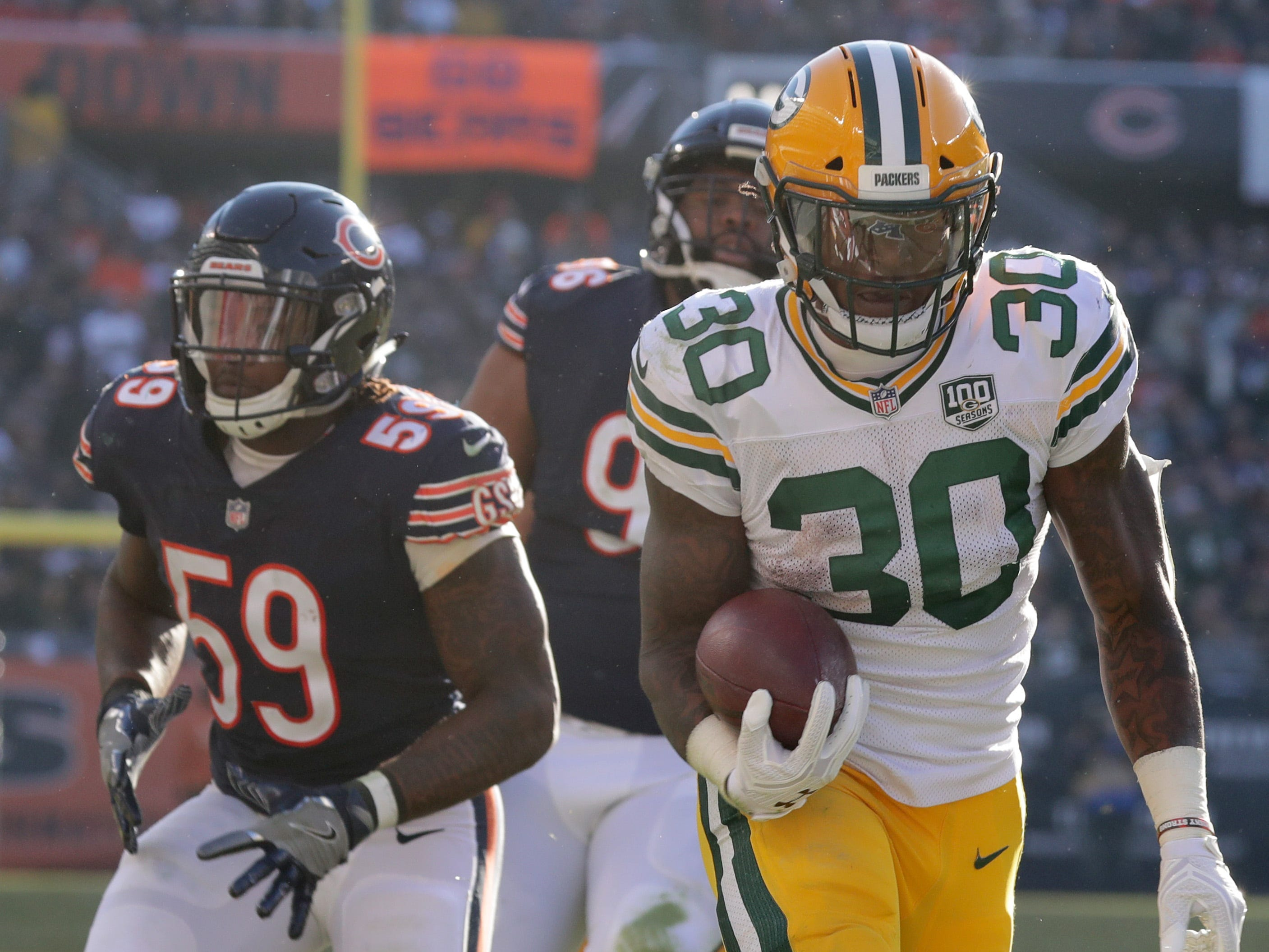 Green Bay Packers running back Jamaal Williams (30) scores a touchdown on a 10-yard run during the third  quarter of their game against the Chicago Bears Sunday, December 25, 2018 at Soldier Field in Chicago, Ill. The Chicago Bears beat the Green Bay Packers 24-17.  MARK HOFFMAN/MILWAUKEE JOURNAL SENTINEL