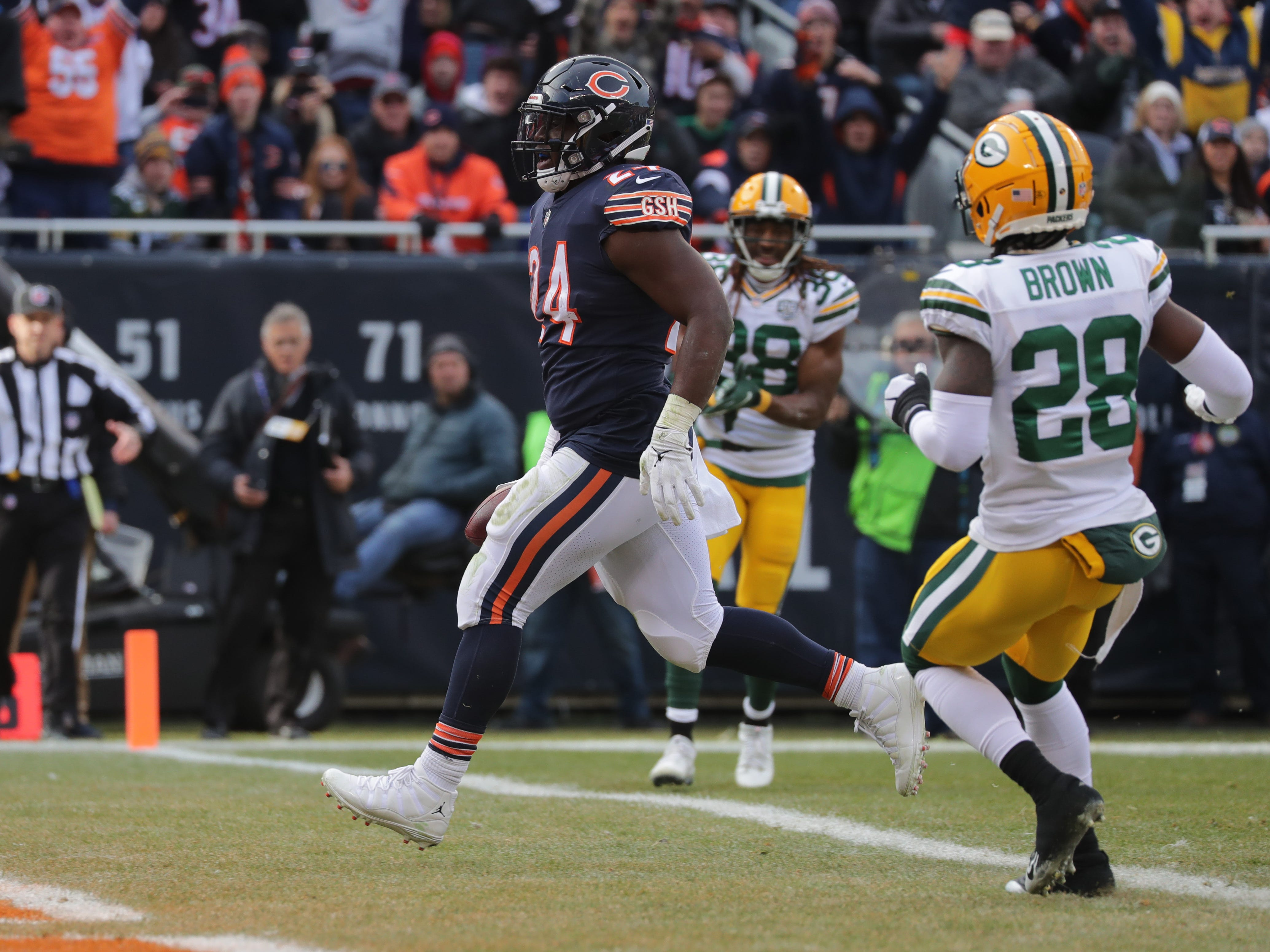 Chicago Bears running back Jordan Howard (24) scores a touchdown n nine yard run during the first quarter of their game against the Green Bay Packers Sunday, December 25, 2018 at Soldier Field in Chicago, Ill.  MARK HOFFMAN/MILWAUKEE JOURNAL SENTINEL