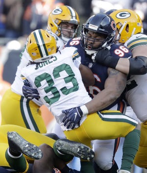Chicago Bears defensive end Akiem Hicks (96) tackles Green Bay Packers running back Aaron Jones (33) in the first quarter at Soldier Field on Sunday, December 16, 2018 in Chicago, Illinois. Adam Wesley/USA TODAY NETWORK-Wis