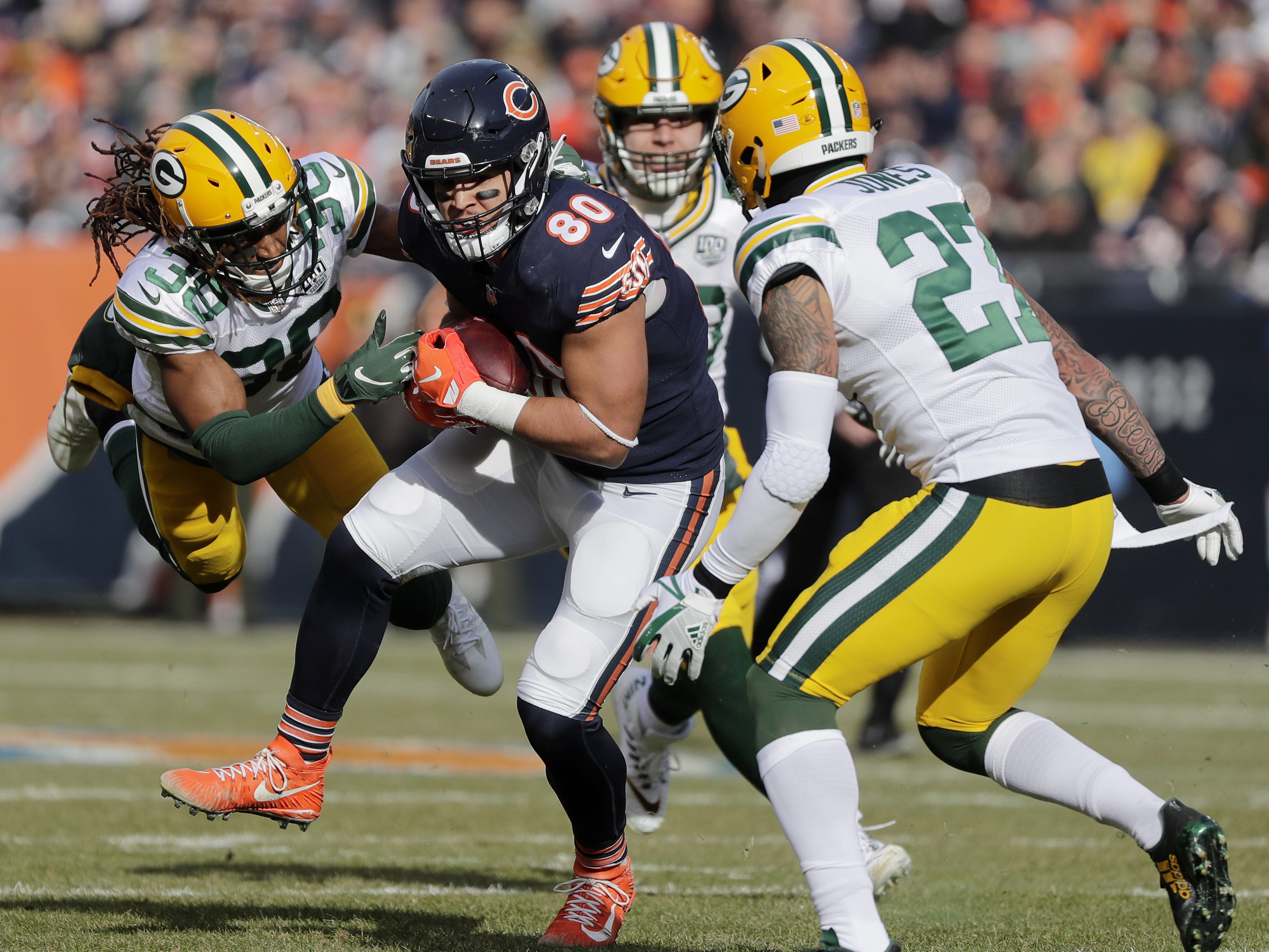 Chicago Bears tight end Trey Burton (80) runs after a catch as Green Bay Packers cornerback Tramon Williams (38) and defensive back Josh Jones (27) defend in the first quarter at Soldier Field on Sunday, December 16, 2018 in Chicago, Illinois. Adam Wesley/USA TODAY NETWORK-Wis