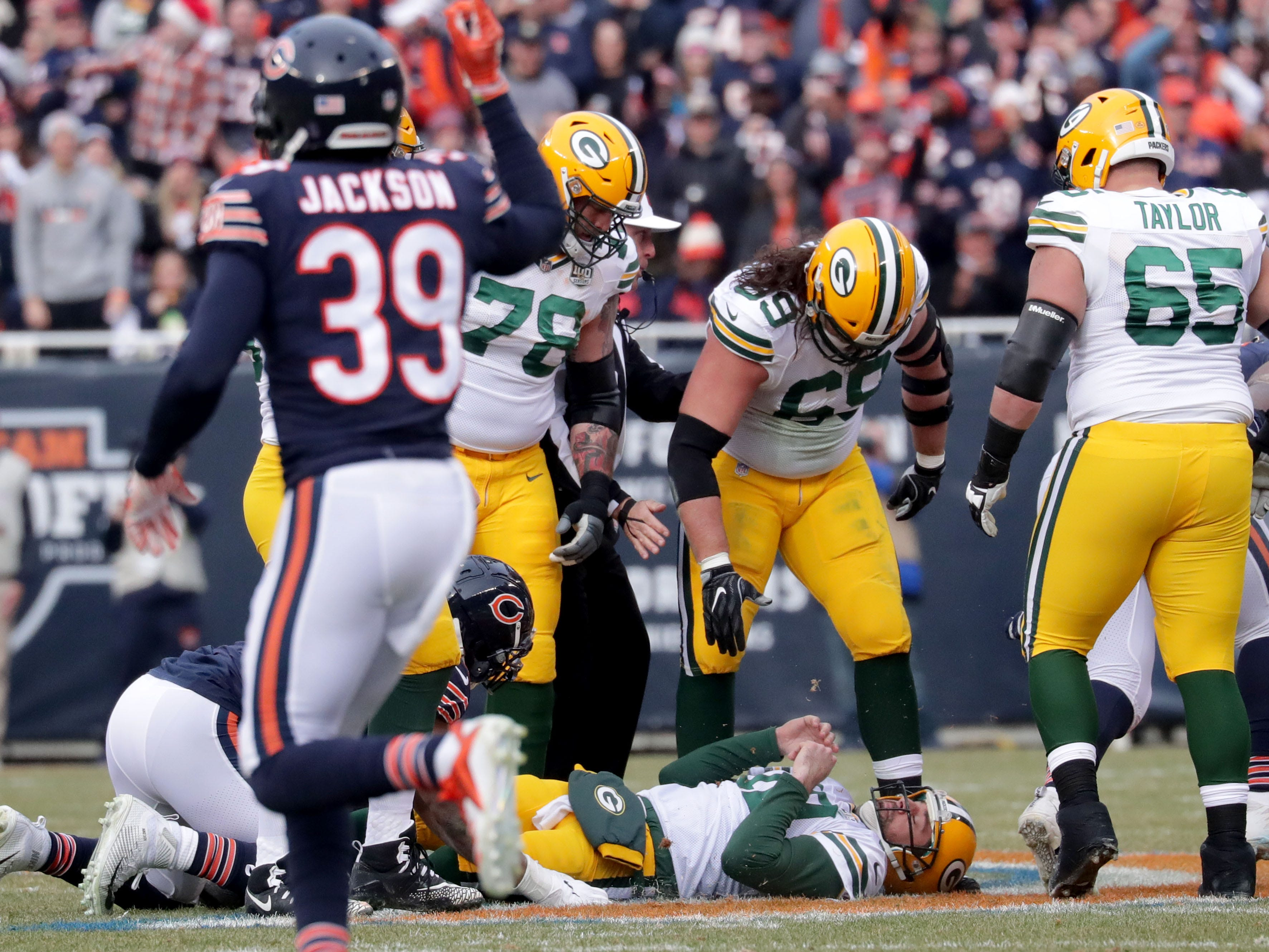 Green Bay Packers' Aaron Rodgers lays on the ground after a sack during the 1st half of the Green Bay Packers game against the Chicago Bears at Soldier Field Sunday, Dec. 16, 2018, in Chicago. Photo by Mike De Sisti / The Milwaukee Journal Sentinel