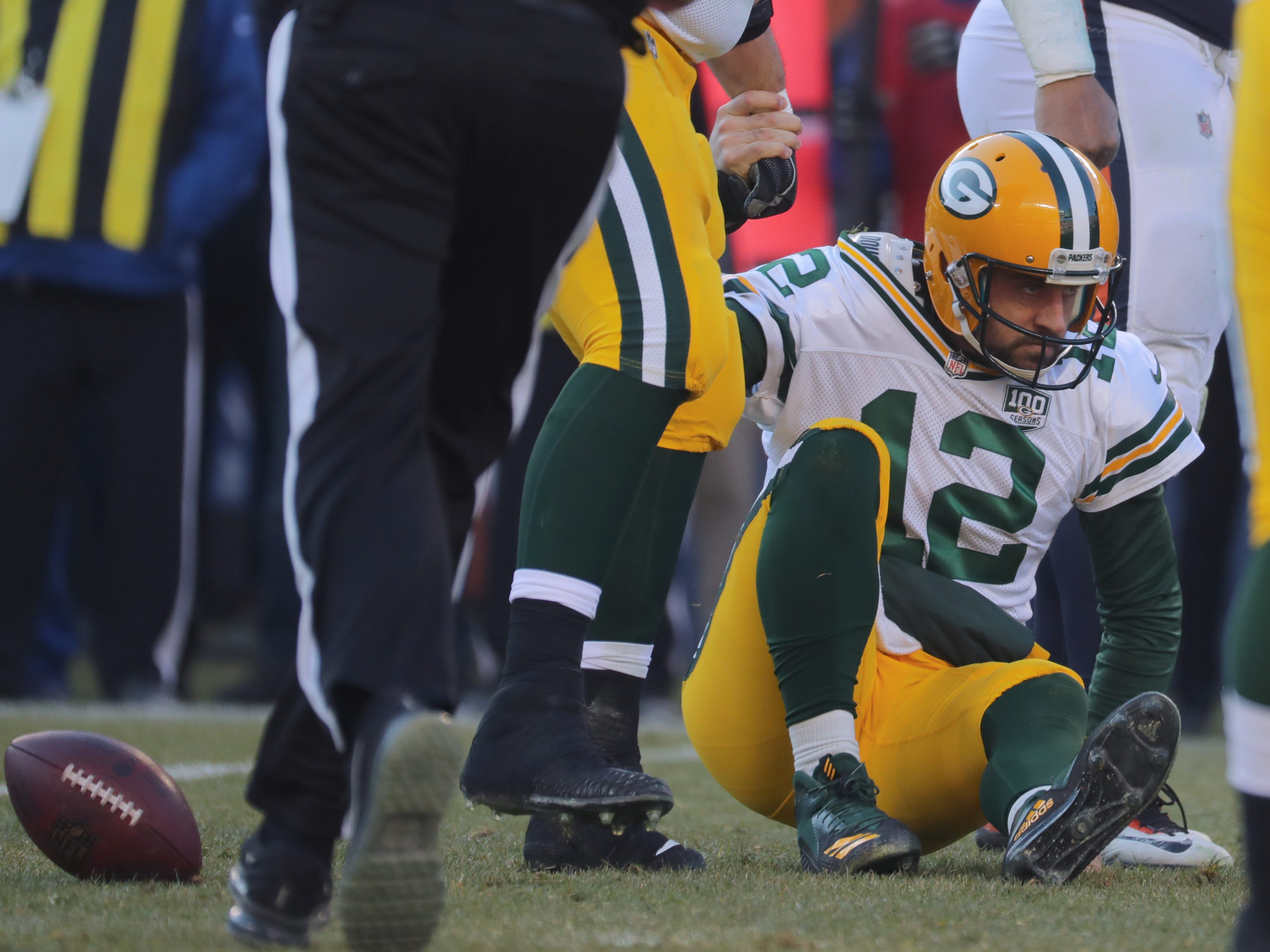 Green Bay Packers quarterback Aaron Rodgers (12) is helped up after being sacked during the fourth quarter of their game Sunday, December 25, 2018 at Soldier Field in Chicago, Ill. The Chicago Bears beat the Green Bay Packers 24-17.  MARK HOFFMAN/MILWAUKEE JOURNAL SENTINEL