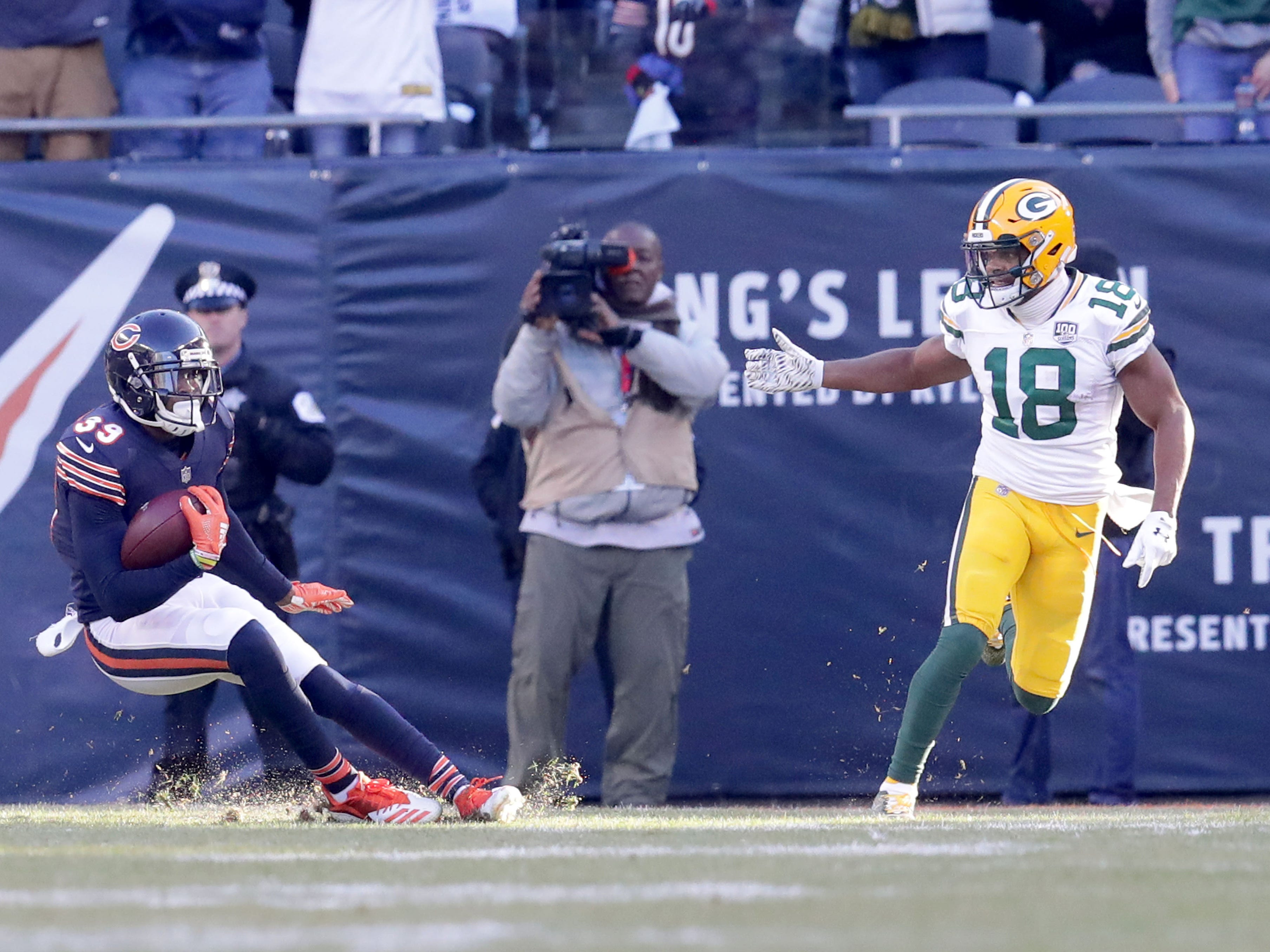 Chicago Bears' Eddie Jackson slides on the turf after and interception of Aaron Rodgers pass during the 2nd half of the Green Bay Packers 24-17 loss to the Chicago Bears at Soldier Field Sunday, Dec. 16, 2018, in Chicago. Photo by Mike De Sisti / The Milwaukee Journal Sentinel