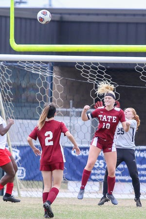 Tate's Makenna Stafford (10) clears the Clinton shot with a header at Gulf Breeze High School on Saturday, December 15, 2018.