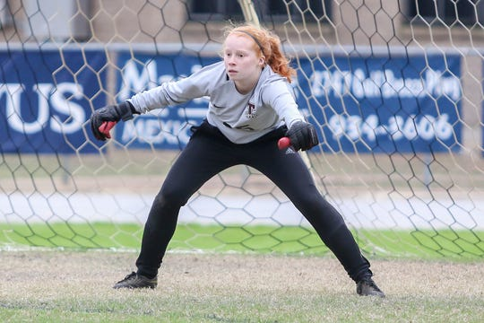 Tate goaltender Madison Christman (25) sets up and watches as Clinton brings the into her zone at Gulf Breeze High School on Saturday, December 15, 2018.