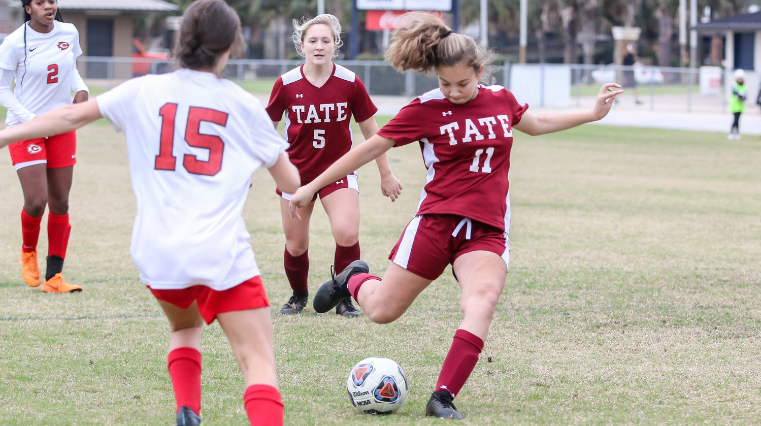 Tate's Camille Macks (11) passes the ball against Clinton at Gulf Breeze High School on Saturday, December 15, 2018.