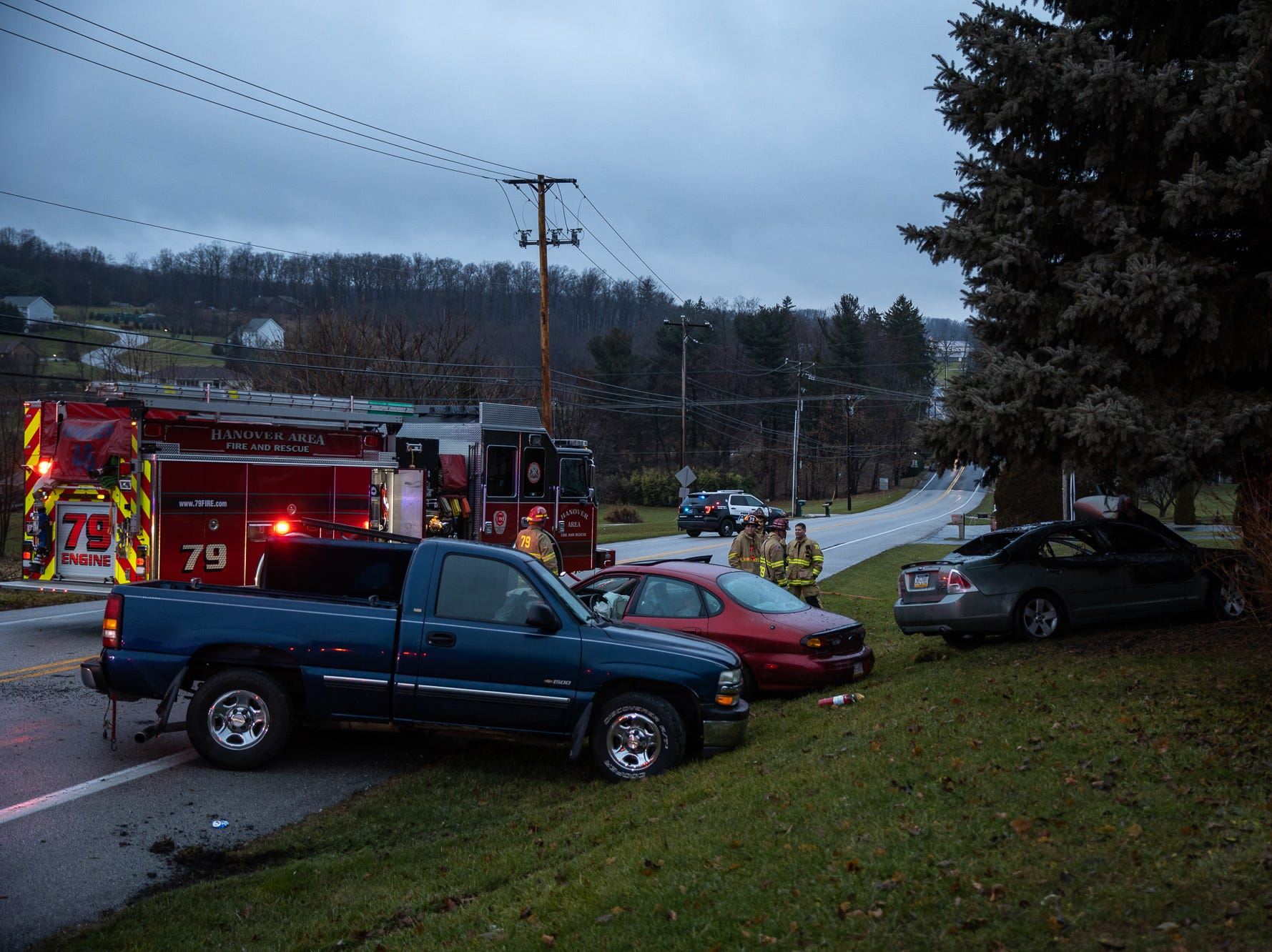 Firefighters work at the scene of a three-vehicle crash with a fully involved car fire and three injuries on the 2200 block of Broadway in Penn Township on Dec. 16. Two women were taken to the hospital following the crash, according to officials.