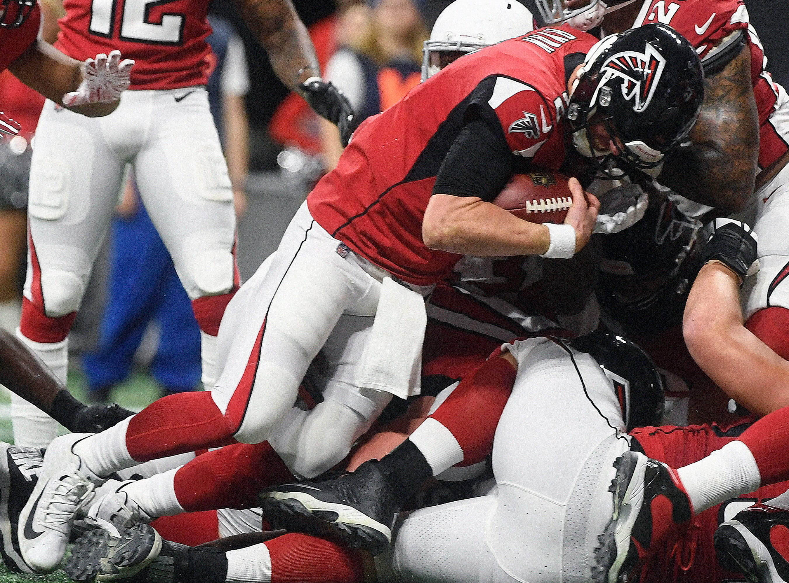 Atlanta Falcons quarterback Matt Ryan (2) falls into the end zone for a touchdown during the first half of an NFL football game against the Arizona Cardinals, Sunday, Dec. 16, 2018, in Atlanta.